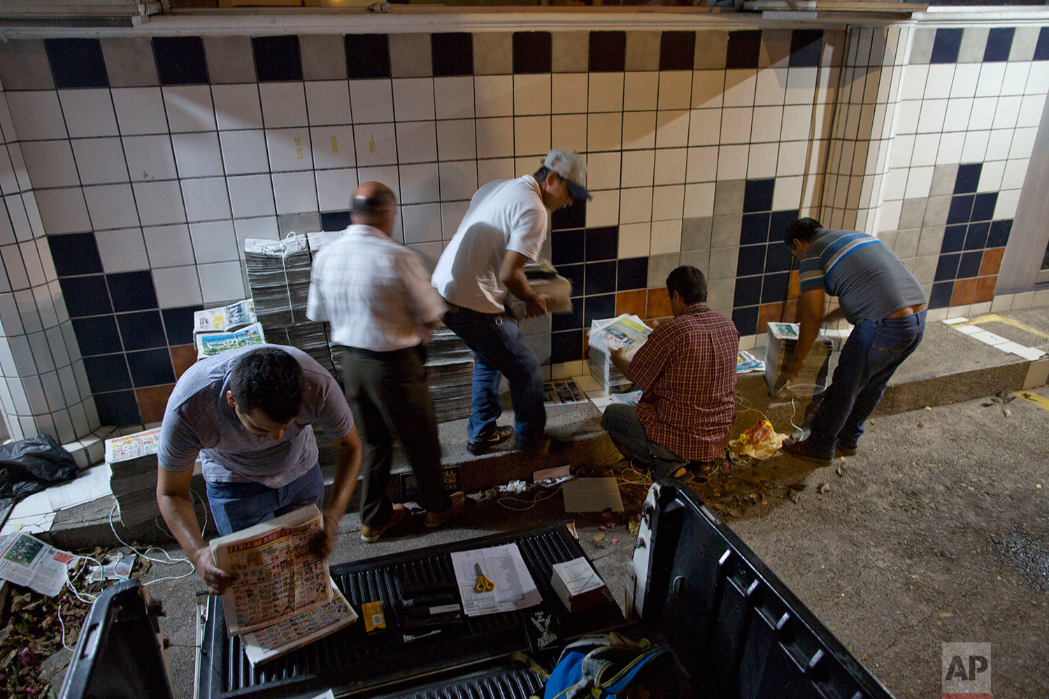 In this July 3, 2017 photo, drivers prepare to distribute Riodoce newspapers in Culiacan, Sinaloa state, Mexico. Riodoce, a weekly publication, was created in 2003 by five local journalists. Over time the paper earned a reputation for brave and honest coverage. (AP Photo/Enric Marti)