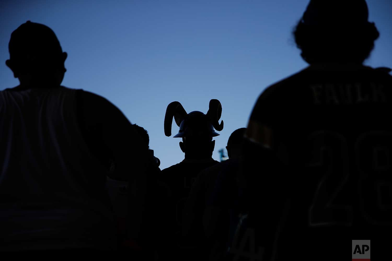 Fans watch the Los Angeles Rams practice at NFL football training camp in Irvine, Calif., on Saturday, July 29, 2017. (AP Photo/Jae C. Hong)