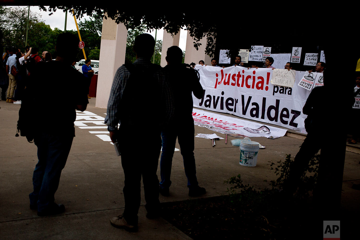 In this June 28, 2017 photo, journalists protest outside the Sinaloa state attorney's general office, after the killing of yet another journalist, and demand justice for the killing of Javier Valdez in Culiacan, Sinaloa state, Mexico. On the morning of May 15, Valdez left his Riodoce office and managed to drive just a couple of blocks before his red Toyota Corolla was stopped by two men; he was forced out of his car and shot 12 times. (AP Photo/Enric Marti)