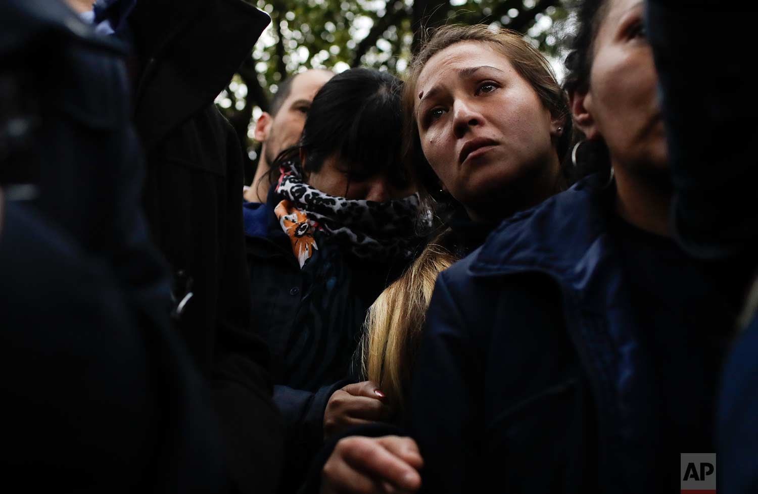 Worker Karina Lopez stands next to her team workers after clashes with police outside the PepsiCo plant on the outskirts of Buenos Aires, Argentina, Thursday, July 13, 2017. (AP Photo/Natacha Pisarenko)
