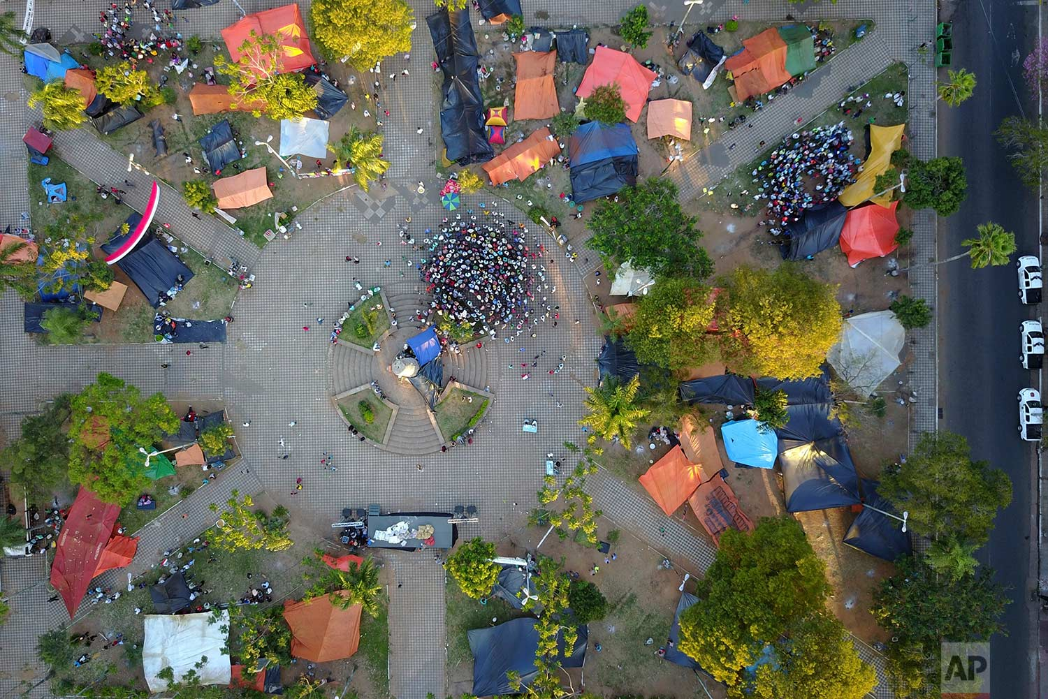 """Farmers from northern Paraguay participate in a meeting at their camp at the """"Plaza de Armas"""" in downtown Asuncion, Paraguay, Wednesday, July 12, 2017. (AP Photo/Jorge Saenz)"""