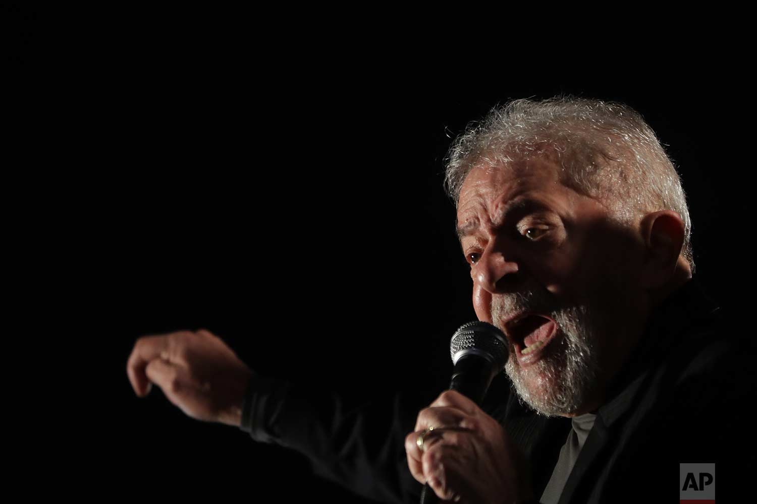 Brazil's former President Luiz Inacio Lula da Silva addresses supporters protesting his conviction in Sao Paulo, Brazil, Thursday, July 20, 2017, after a judge ordered the seizure of more than $2.8 million in pension funds from Silva in connection with his corruption conviction. (AP Photo/Andre Penner)