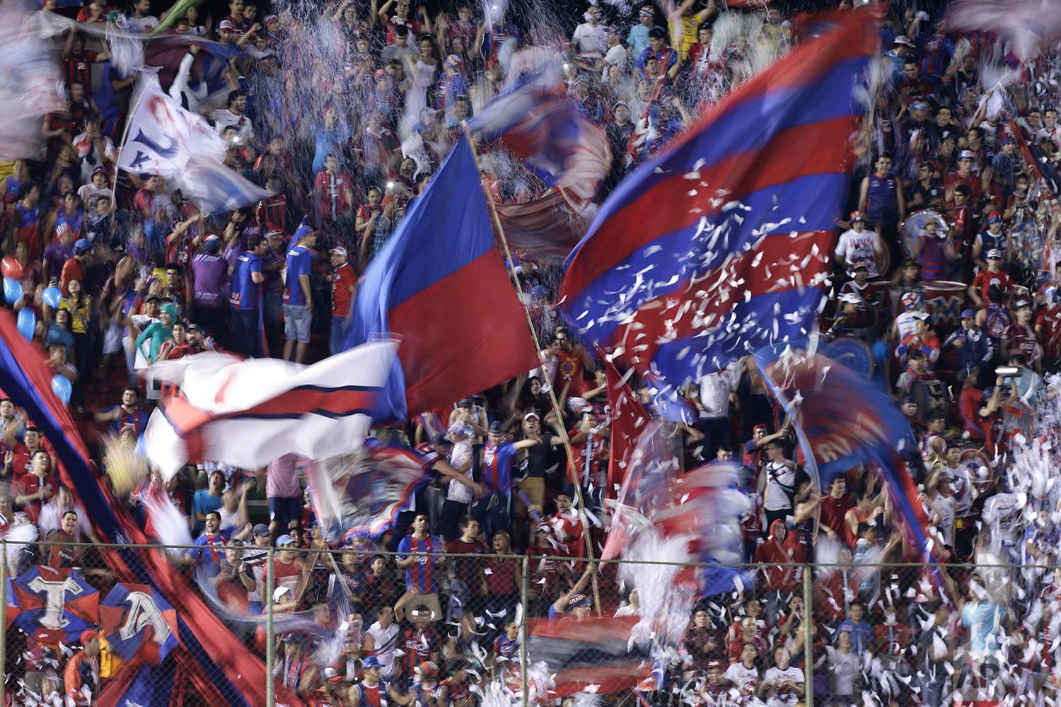 Fans of Paraguay's Cerro Porteno cheer for their team during a Copa Sudamericana soccer match against Uruguay's Boston River in Asuncion, Paraguay, Tuesday, July 11, 2017. (AP Photo/Jorge Saenz)