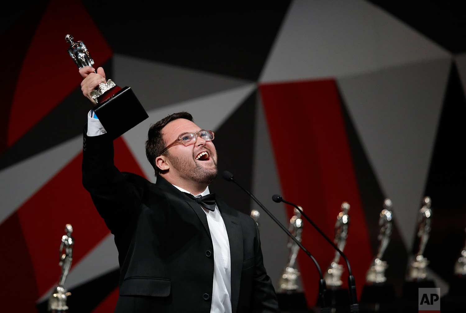 """Paco de la Fuente celebrates after he was presented with the best new actor award for his performance in """"El alien y yo"""", at the 59th Ariel Awards ceremony at the Palacio de Bellas Artes in Mexico City, Tuesday, July 11, 2017. (AP Photo/Rebecca Blackwell)"""