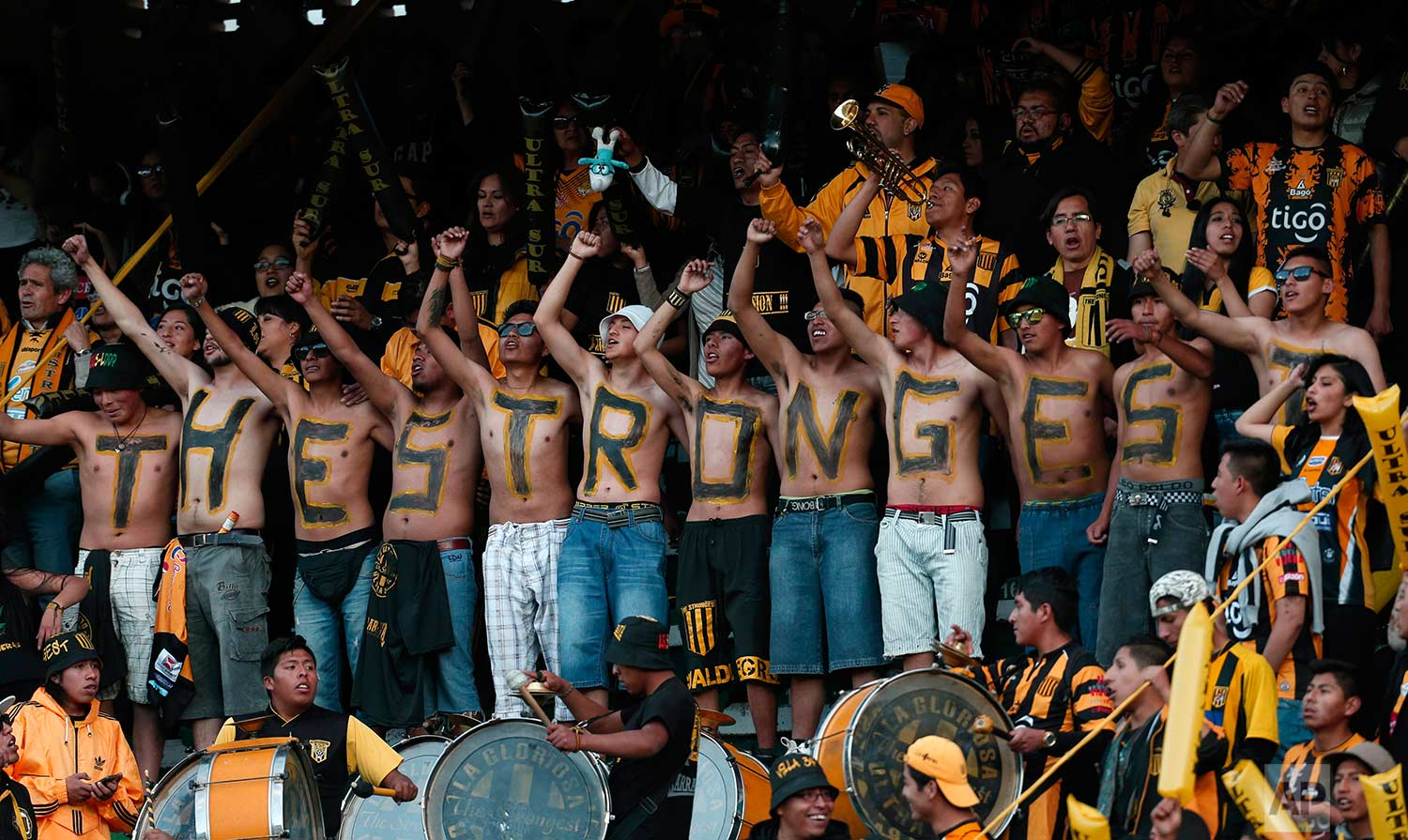 Fans of Bolivia's The Strongest cheer for their team before a Copa Libertadores soccer match against Argentina's Lanus in La Paz, Bolivia, Thursday, July 6, 2017. (AP Photo/Juan Karita)