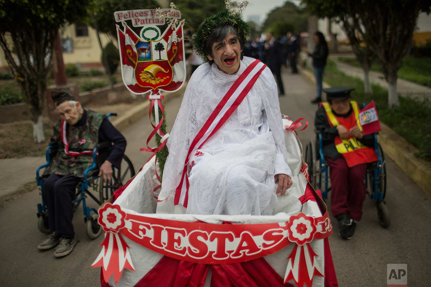 Larco Herrera Psychiatric Hospital patients wait to take part in the hospital's Independence Day parade, in Lima, Peru, Friday, July 21, 2017. (AP Photo/Rodrigo Abd)