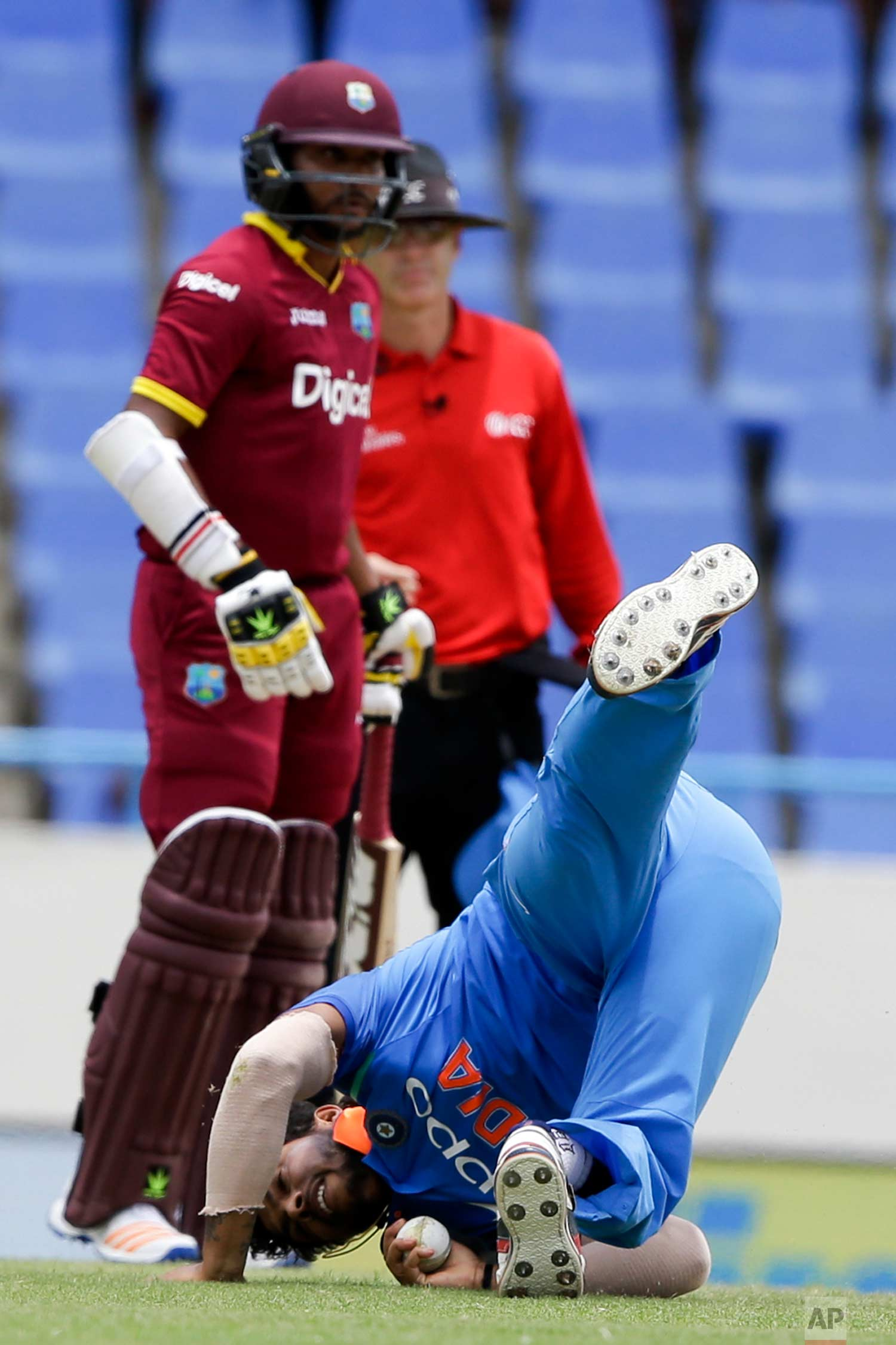 India's Umesh Yadav takes the catch from his own bowling to dismiss West Indies' Ashley Nurse during their fourth ODI cricket match at the Sir Vivian Richards Stadium in North Sound, Antigua and Barbuda, Sunday, July 2, 2017. (AP Photo/Ricardo Mazalan)