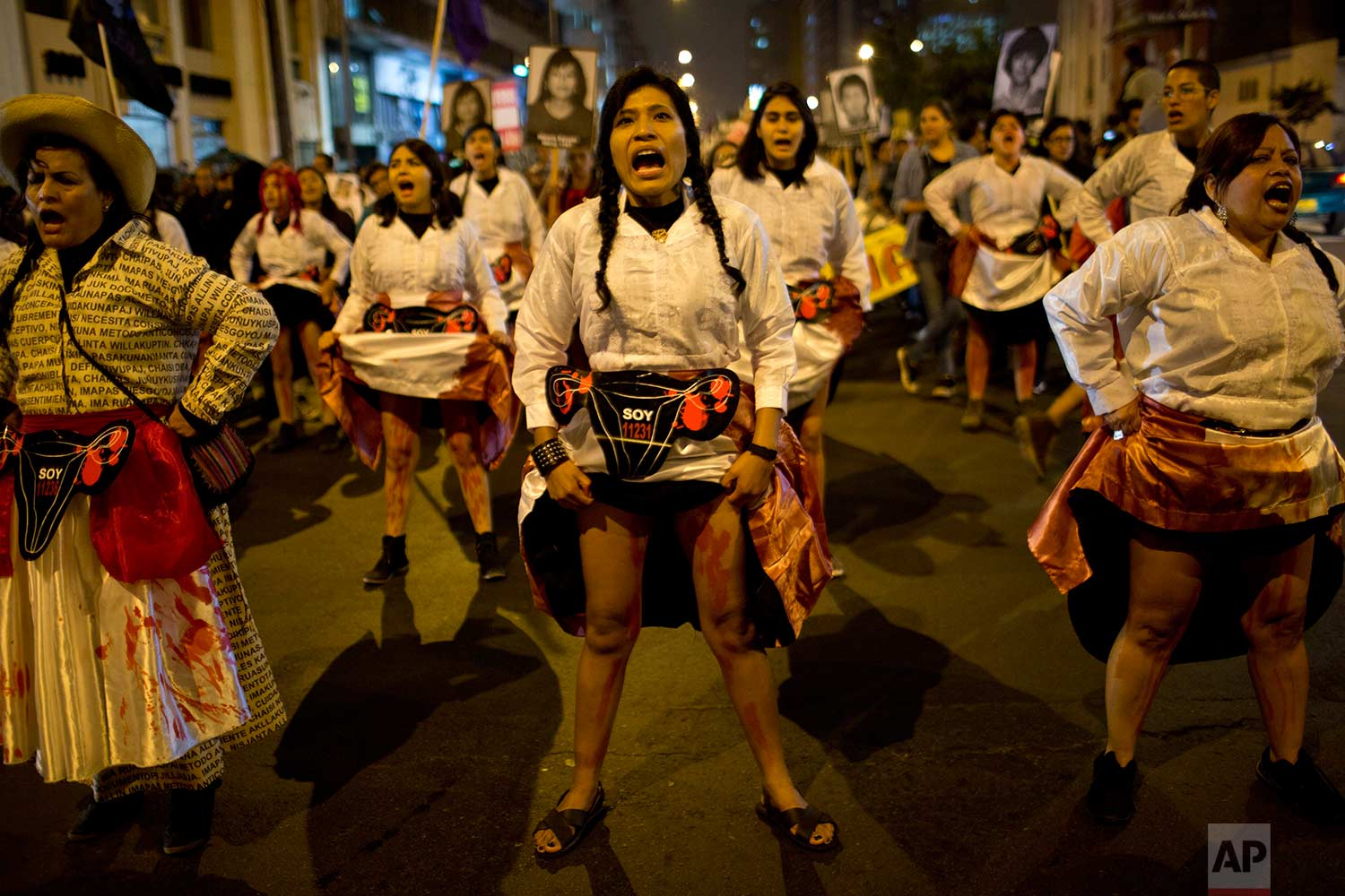 Protesters, representing forcibly sterilized women by the government during the presidency of Alberto Fujimori, perform during a march in Lima, Peru, Friday, July 7, 2017. (AP Photo/Rodrigo Abd)