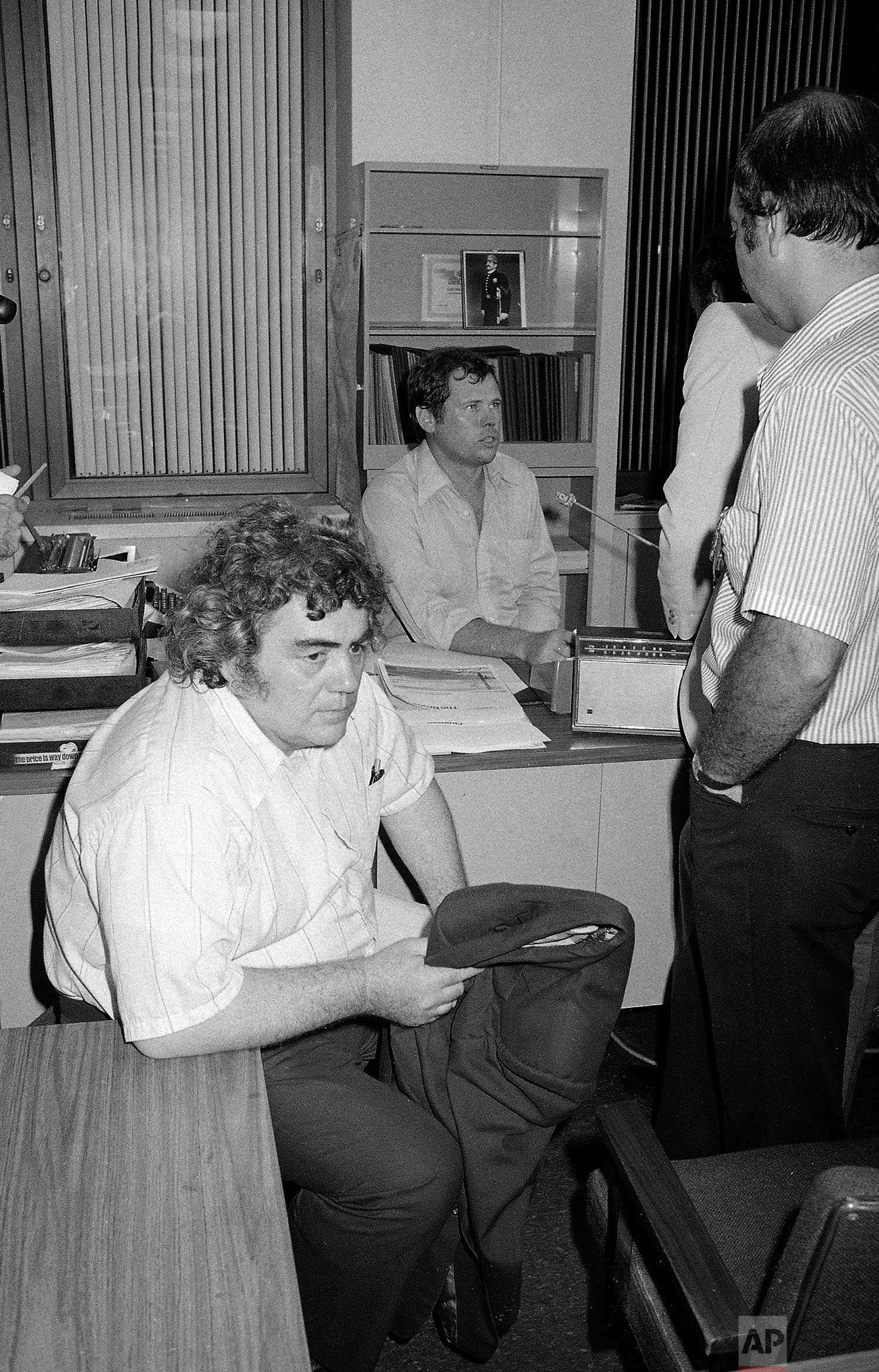 "New York Daily News columnist Jimmy Breslin sits at police headquarters in New York after the arrest of David Berkowitz, the ""Son of Sam"" serial killer suspect, on Aug. 11, 1977. Berkowitz sent several cryptic messages to Breslin, who published them in the newspaper. (AP Photo)"