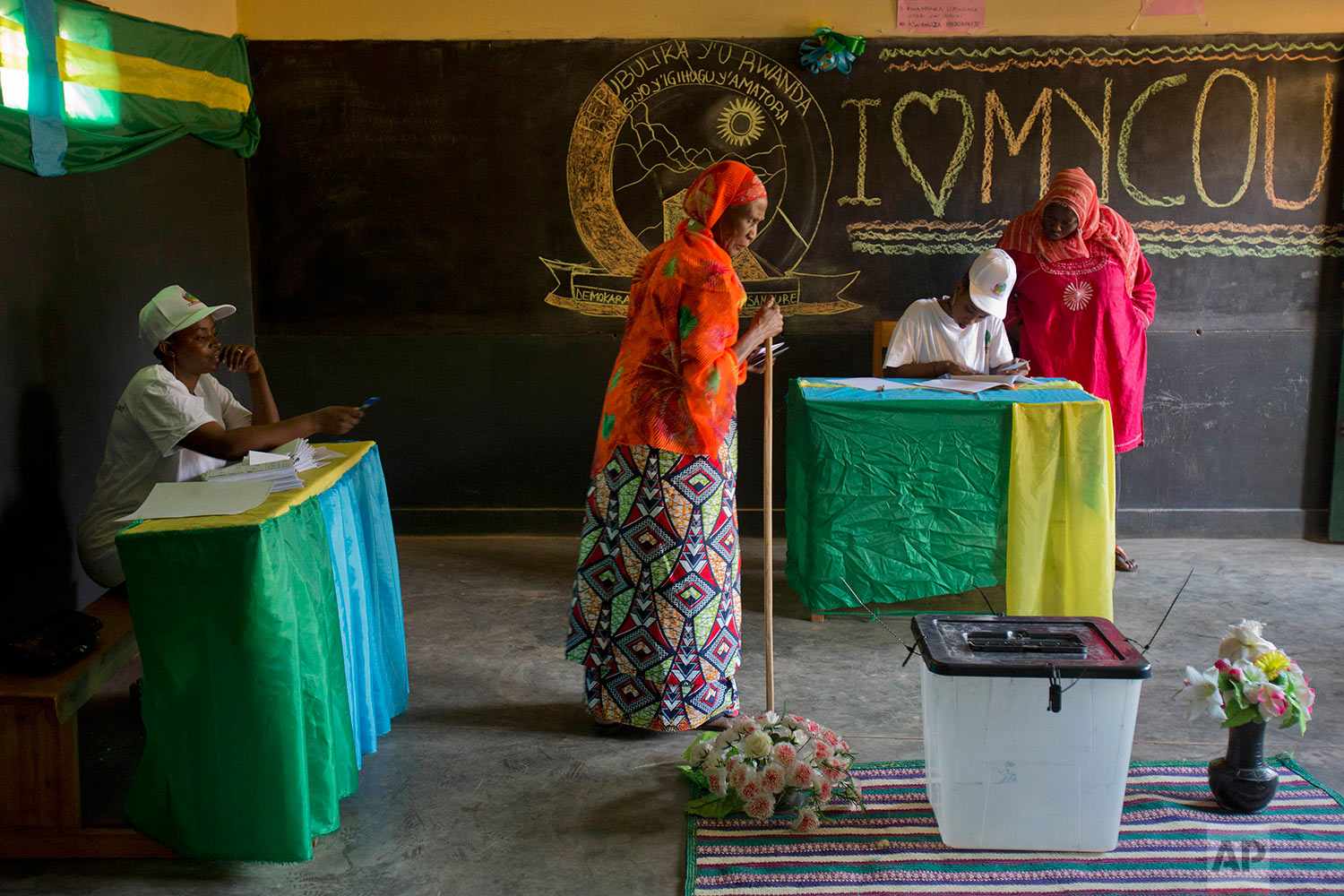 Rwandans prepare to vote for the presidential elections at a polling station in Rwanda's capital Kigali Friday, Aug. 4, 2017. Outgoing President Paul Kagame is widely expected to win another term after the government disqualified all but three candidates. (AP Photo/Jerome Delay)