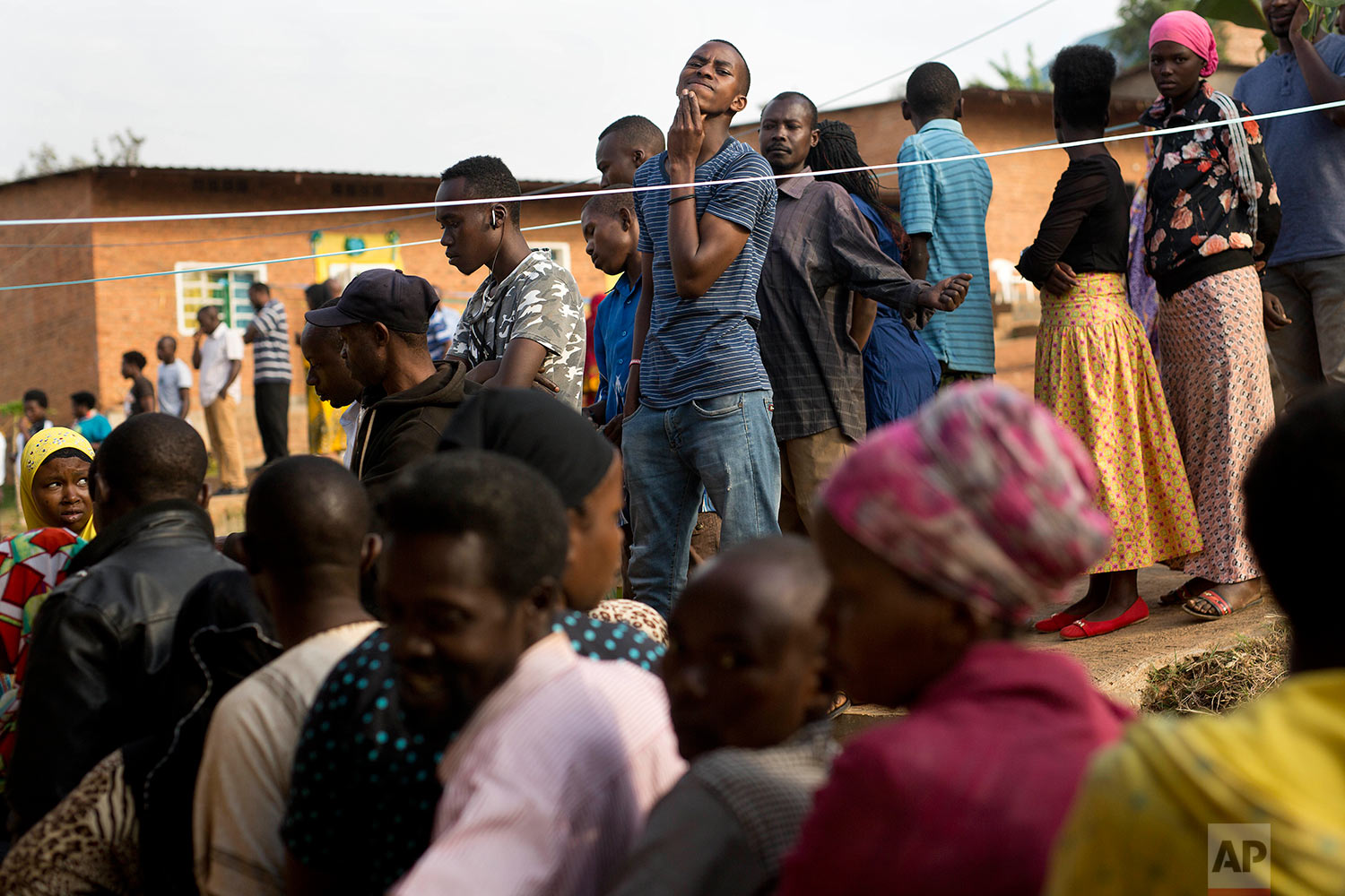 Rwandans line up to vote in a polling station in Rwanda's capital Kigali Friday Aug. 4, 2017 for the presidential elections in which outgoing president Paul Kagame is widely expected to win another term after the government disqualified all but three candidates. (AP Photo/Jerome Delay)