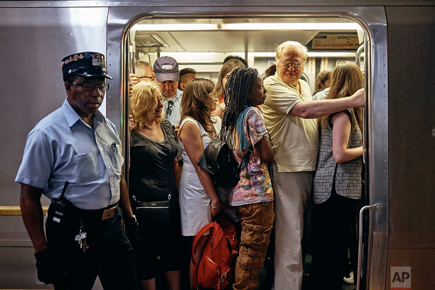 A PATH train packed with commuters is ready for departure from the PATH station in Hoboken Terminal, Monday, July 10, 2017, in Hoboken, N.J. (AP Photo/Andres Kudacki)