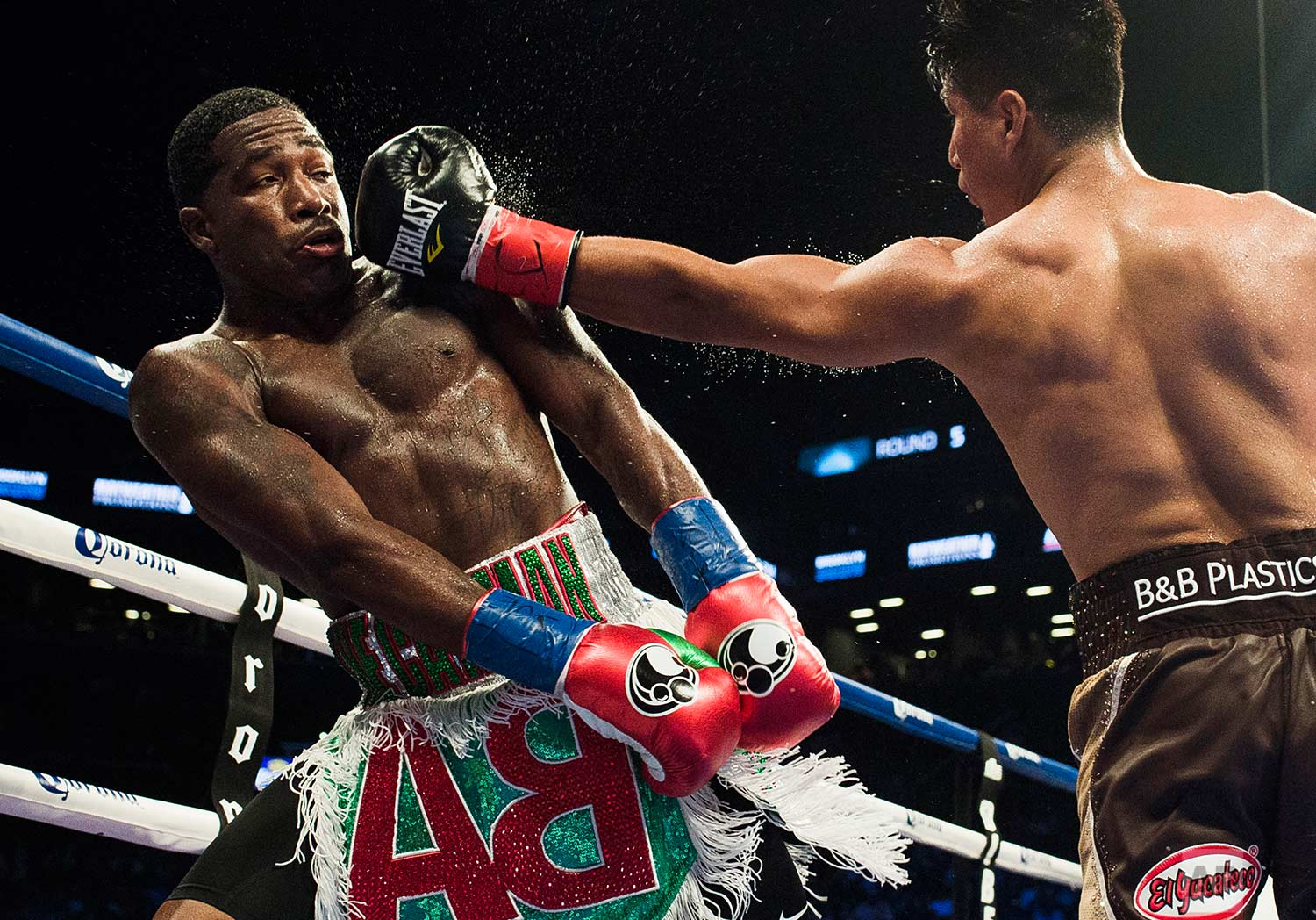 Mikey Garcia, right, hits Adrien Broner, left, during a boxing bout at 140 pounds, Saturday, July 29, 2017, in New York. (AP Photo/Andres Kudacki)