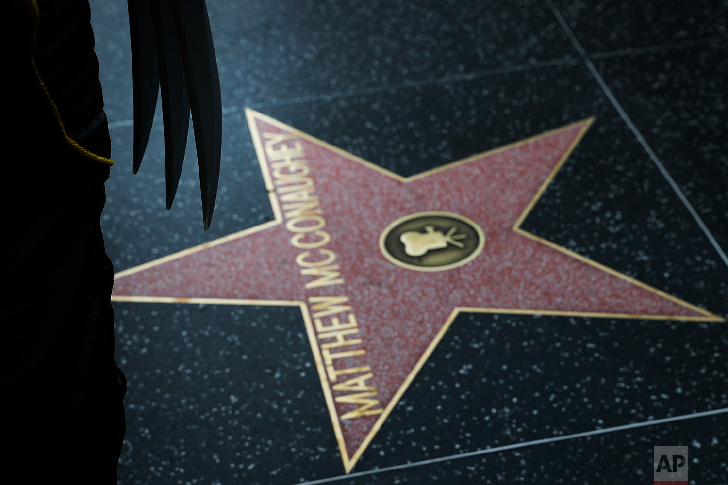 In this Friday, May 26, 2017 photo, Ross Johnson, also known as the Hollywood Wolverine, wears a Marvel Wolverine costume near Matthew McConaughey's star on the Hollywood Walk of Fame, in Los Angeles. Johnson is an actor himself and works as an executive director of a non-profit acting school.  (AP Photo/Jae C. Hong)