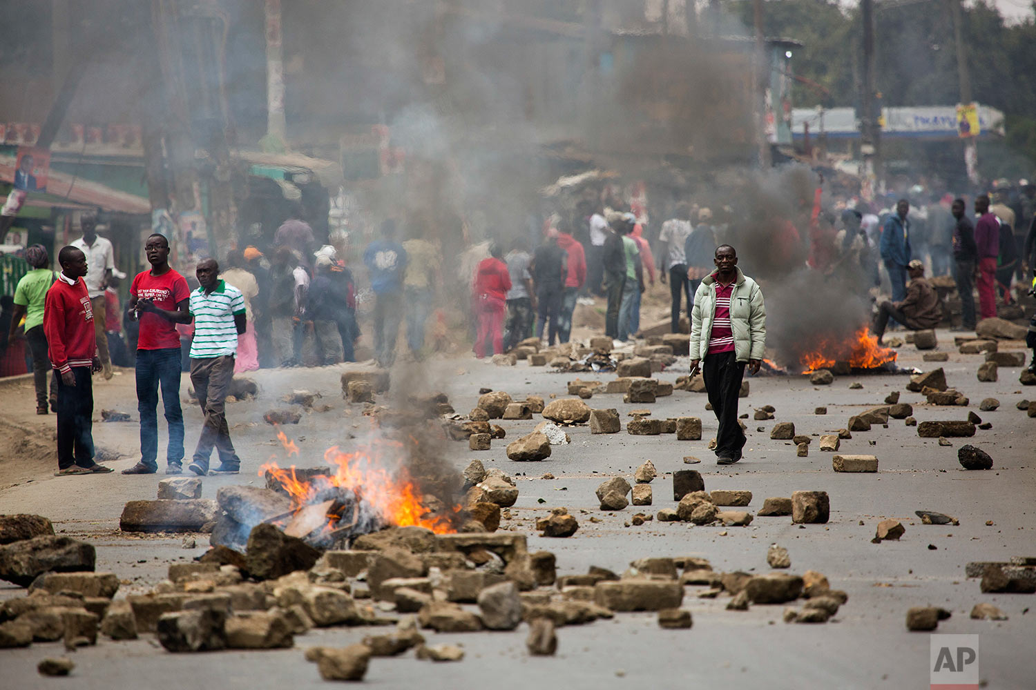 Supporters of Kenyan opposition leader and presidential candidate Raila Odinga demonstrate in the Mathare area of Nairobi Wednesday, Aug. 9, 2017. Kenya's election took an ominous turn on Wednesday as violent protests erupted in the capital and elsewhere after opposition leader Raila Odinga alleged fraud, saying hackers used the identity of a murdered official to infiltrate the database of the country's election commission and manipulate results. (AP Photo/Jerome Delay)