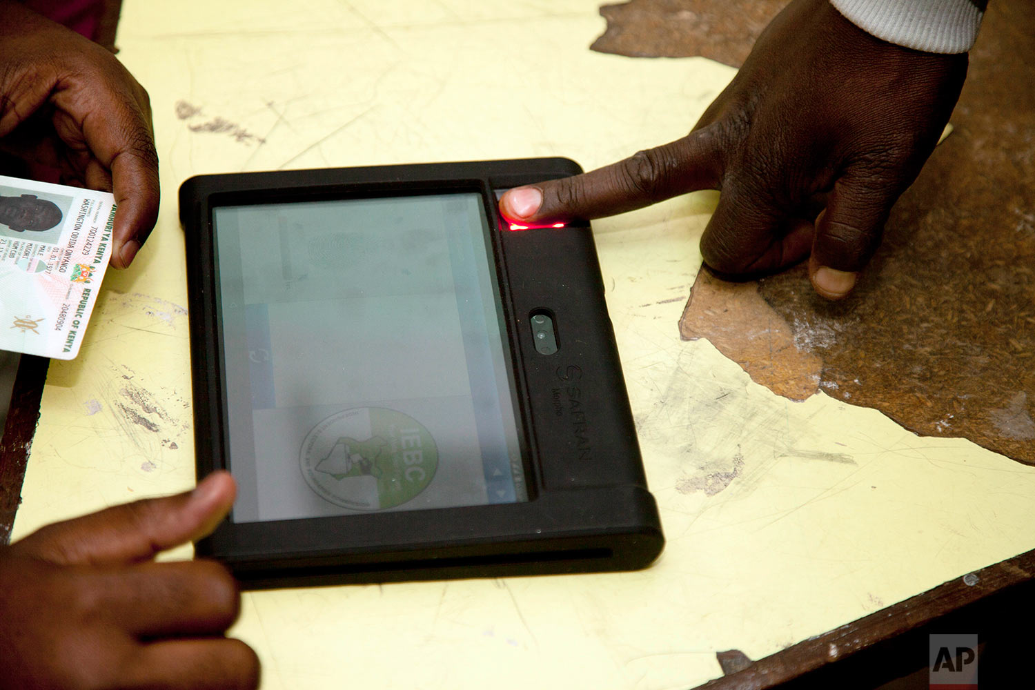 A Kenyan goes through vetting to cast his vote at a polling station in Nairobi, Kenya, Tuesday, Aug. 8, 2017. Kenyans are going to the polls to vote in a general election after a tightly fought presidential race between incumbent President Uhuru Kenyatta and main opposition leader Raila Odinga. (AP Photo/ Sayyid Abdul Azim)