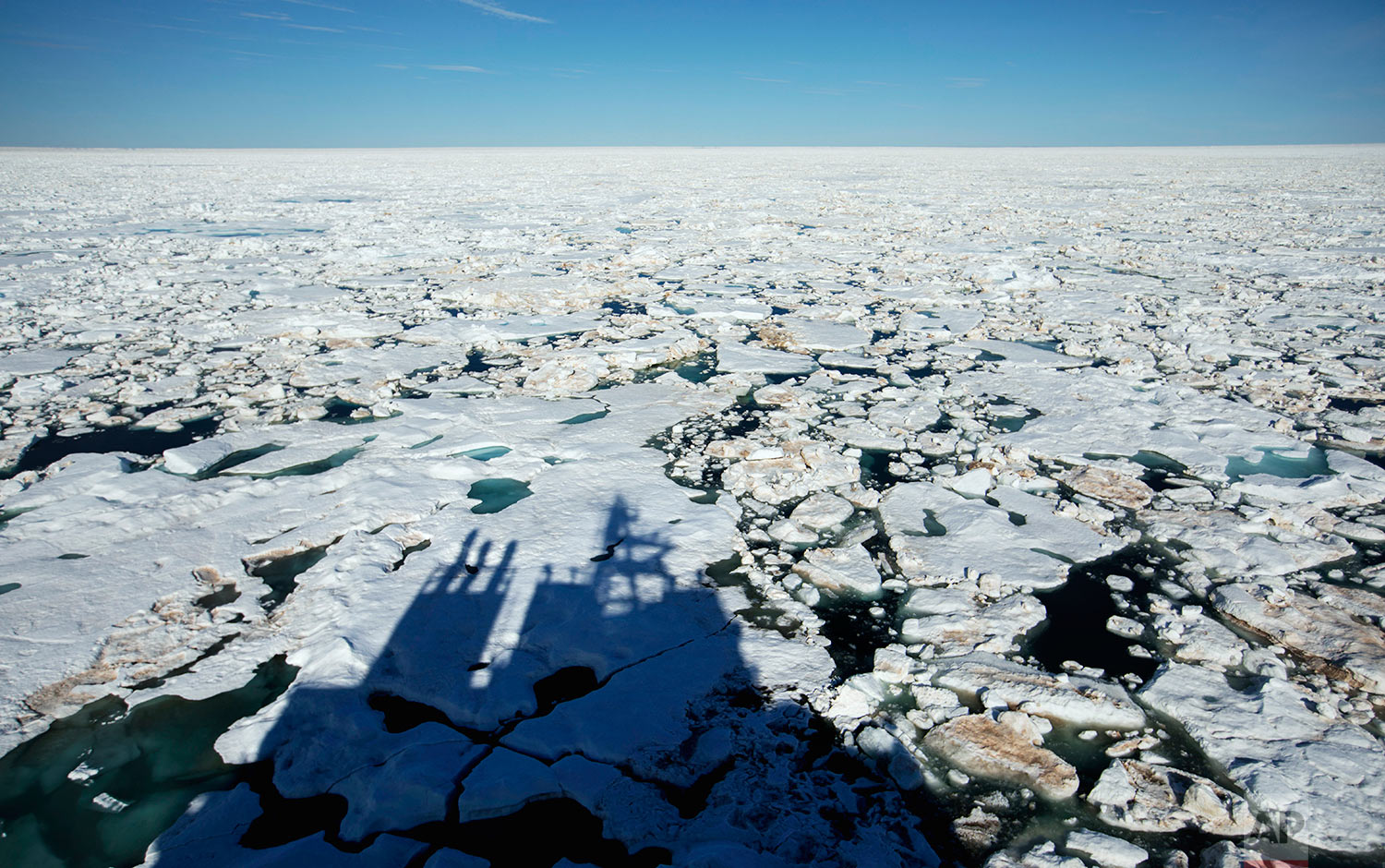 The Finnish icebreaker MSV Nordica casts a shadow on the ice while traversing the Northwest Passage through the Victoria Strait in the Canadian Arctic Archipelago Friday, July 21, 2017. If parts of the planet are becoming like a furnace because of global warming, then the Arctic is best described as the world's air-conditioning unit. The frozen north plays a crucial role in cooling the rest of the planet while reflecting some of the sun's heat back into space. Yet for several decades, satellite pictures have shown a dramatic decline in Arctic sea ice that is already affecting the lives of humans and animals in the region. Experts predict that the impact of melting sea ice will be felt across the northern hemisphere, altering ocean currents and causing freak weather as far south as Florida or France. (AP Photo/David Goldman)