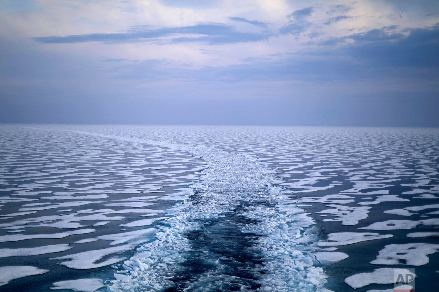 A path in the ice is left in the wake of the Finnish icebreaker MSV Nordica as it traverses the Northwest Passage through the Franklin Strait in the Canadian Arctic Archipelago Saturday, July 22, 2017. Researchers on the trip sought to observe the changes taking place in the region first hand, to gain a clearer picture of the effects of global warming already seen from space. Even the dates of the journey were a clue: The ship departed Vancouver in early July and arrived in Nuuk, Greenland on July 29th, the earliest transit ever of a region that isn't usually navigable until later in the year. (AP Photo/David Goldman)
