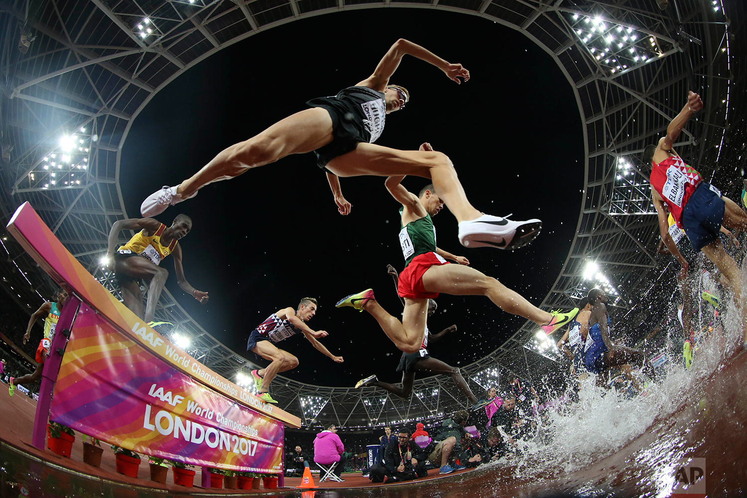 Athletes compete in the men's 3000-meter steeplechase final during the World Athletics Championships in London Tuesday, Aug. 8, 2017. (AP Photo/Matthias Schrader)