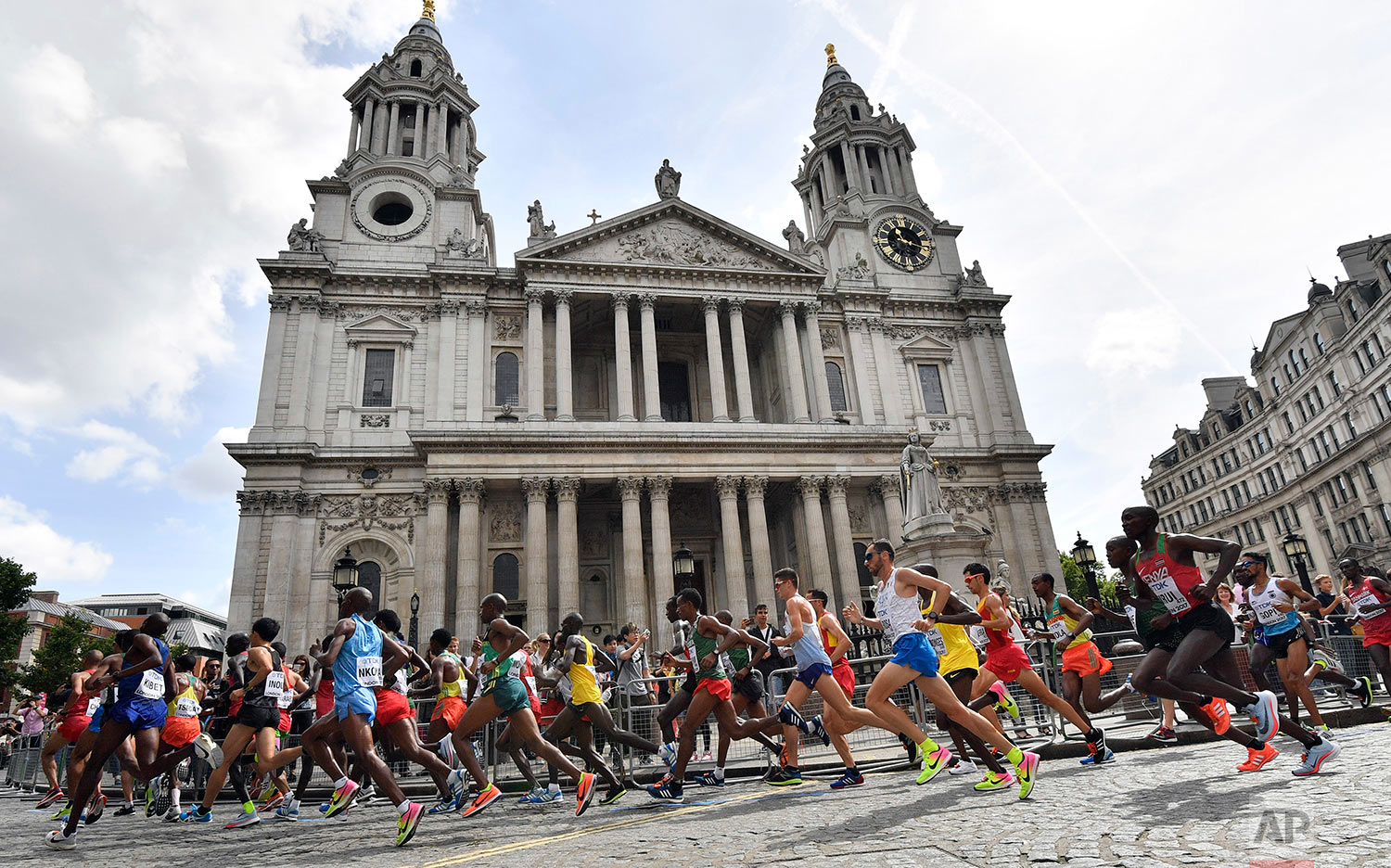 Kenya's Geoffrey Kipkorir Kirui, right, runs past St. Paul's Cathedral in the Men's Marathon during the World Athletics Championships Sunday, Aug. 6, 2017. (AP Photo/Martin Meissner)