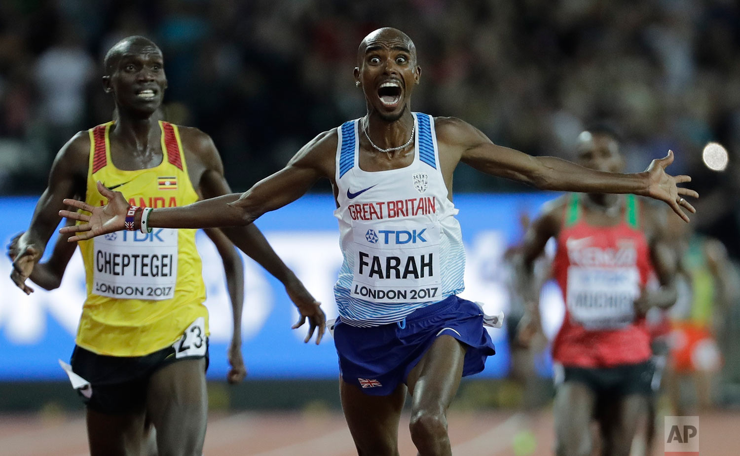 Britain's Mo Farah crosses the line ahead of Uganda's Joshua Kiprui Cheptegei to win the gold medal in the Men's 10,000m final during the World Athletics Championships in London, Friday, Aug. 4, 2017. (AP Photo/David J. Phillip)