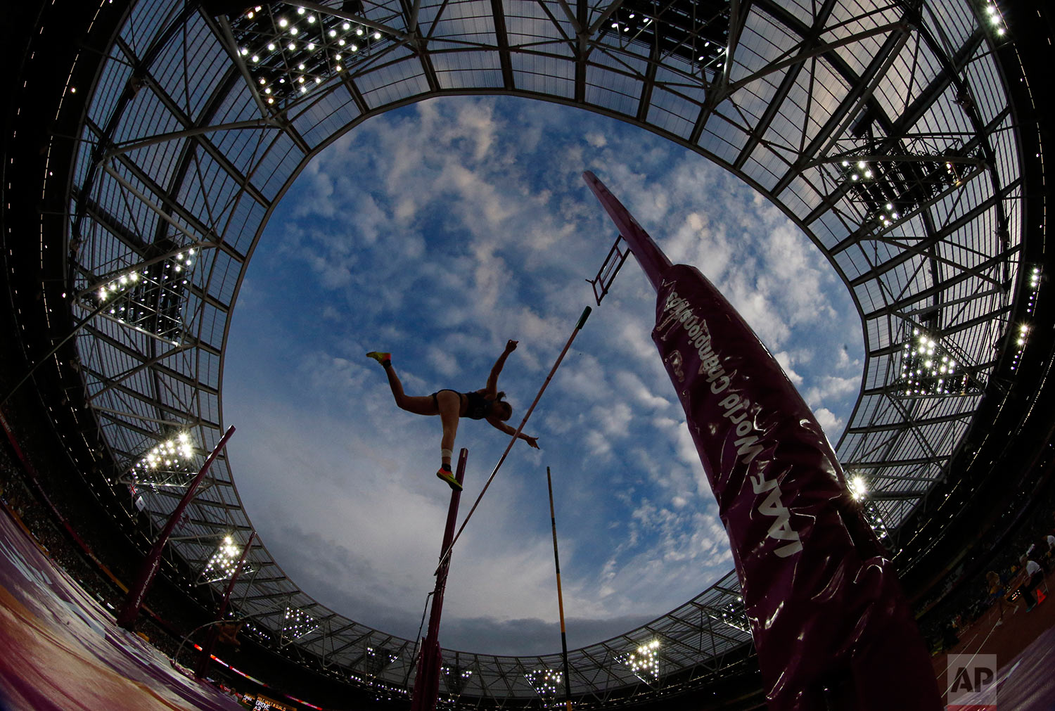 United States' Emily Grove competes in the women's pole vault qualification during the World Athletics Championships in London Friday, Aug. 4, 2017. (AP Photo/Matthias Schrader)