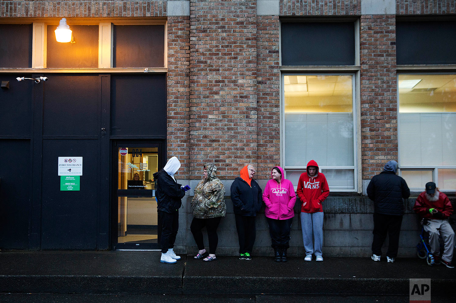 """People wait in line for the Evergreen Treatment Services methadone clinic to open in Hoquiam, Wash., Thursday, June 15, 2017. Penn State sociologist Shannon Monnat spent last fall plotting places on a map experiencing a rise in """"deaths of despair"""" _ from drugs, alcohol and suicide wrought by the decimation of jobs that used to bring dignity. On Election Day, a television map of Trump's victory looked eerily similar to hers documenting death, from New England through the Rust Belt all the way here, to the rural coast of Washington. (AP Photo/David Goldman)"""