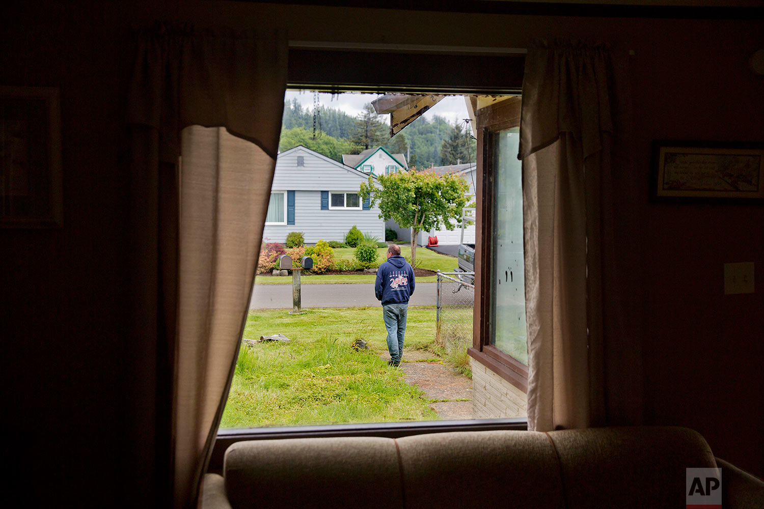 """Robert LaCount, a recovering addict, shows a young woman's funeral program in Hoquiam, Wash., on Monday, June 12, 2017. He walked her down the aisle at her wedding and eight months later carried the casket at her funeral. The mother of three had been addicted to heroin, recovered, relapsed and hanged herself. """"It's too sad,"""" says LaCount, himself a recovering addict. """"But it happens all the time."""" (AP Photo/David Goldman)"""