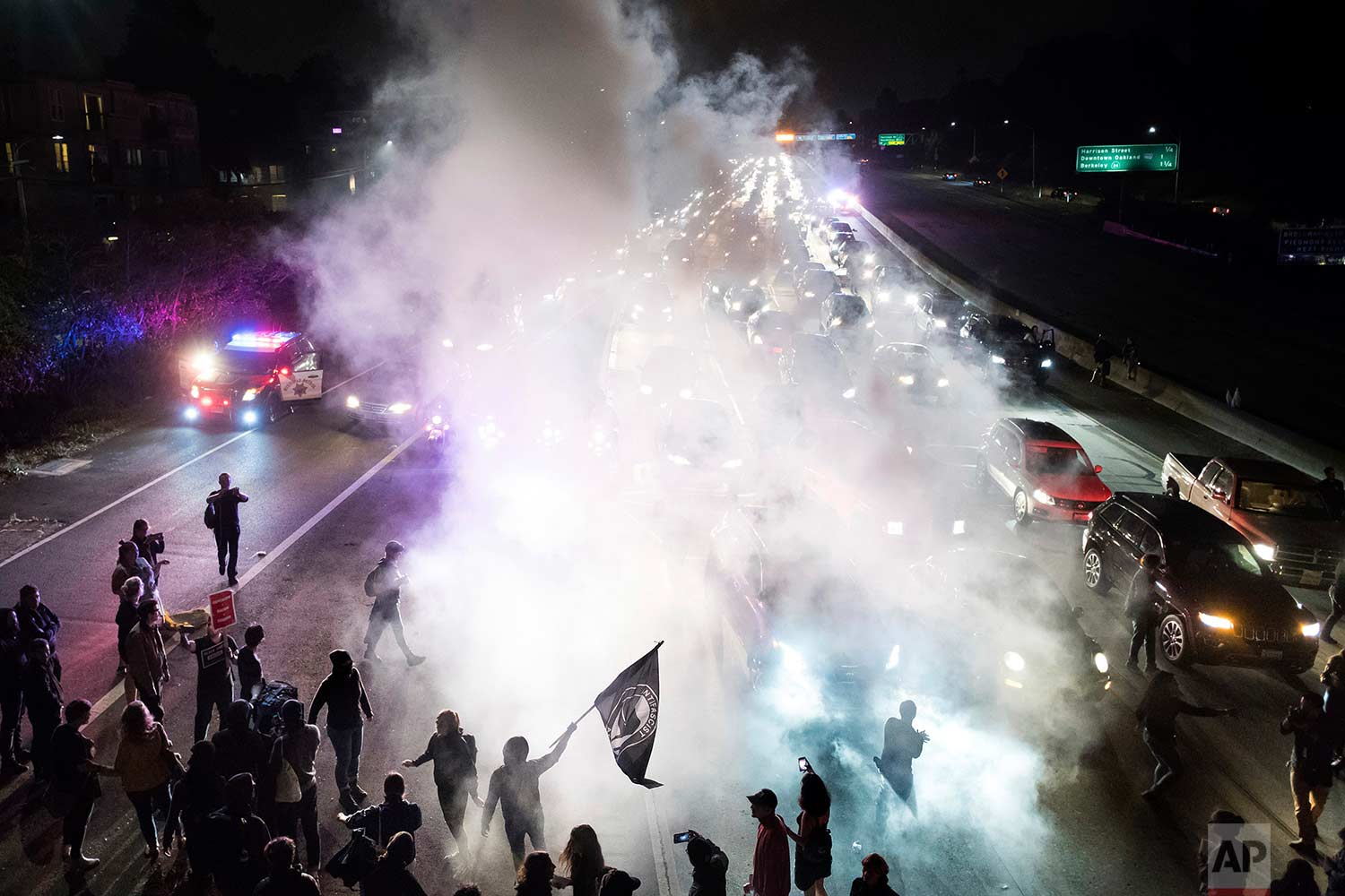 Protesters against racism block traffic for both directions of Interstate 580 in Oakland, Calif., Saturday, Aug. 12, 2017. (AP Photo/Noah Berger)