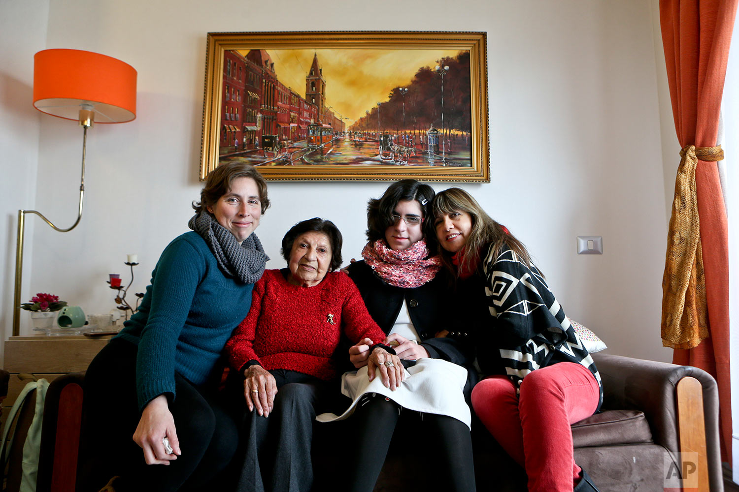 In this June 19, 2017 photo, transgender girl Angela, second from right, poses for a portrait with her mother Ximena Maturana, far left, grandmother, far right, and great-grandmother, at her home in Santiago, Chile. Angela, who was born male, said she still struggles to come to terms with her identity a year after her transition. (AP Photo/Esteban Felix)