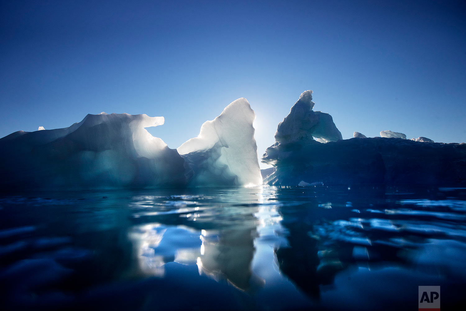 Icebergs float in the Nuup Kangerlua Fjord near Nuuk in southwestern Greenland, Tuesday Aug. 1, 2017. (AP Photo/David Goldman)