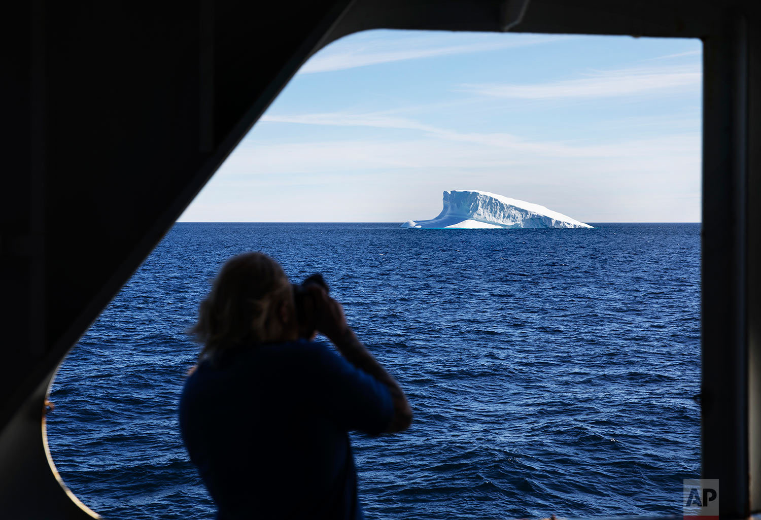 An iceberg floats past the Finnish icebreaker MSV Nordica as it sails the Davis Strait toward Greenland, Thursday, July 27, 2017. (AP Photo/David Goldman)