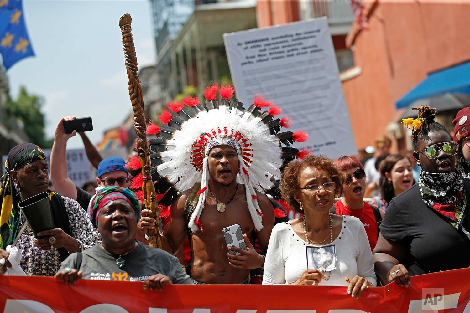 """People participate in a march organized by the group """"Take Em Down NOLA"""" in New Orleans, Saturday, Aug. 19, 2017, to show opposition to white-supremacist rallies and deadly attack in Charlottesville, Va. (AP Photo/Gerald Herbert)"""