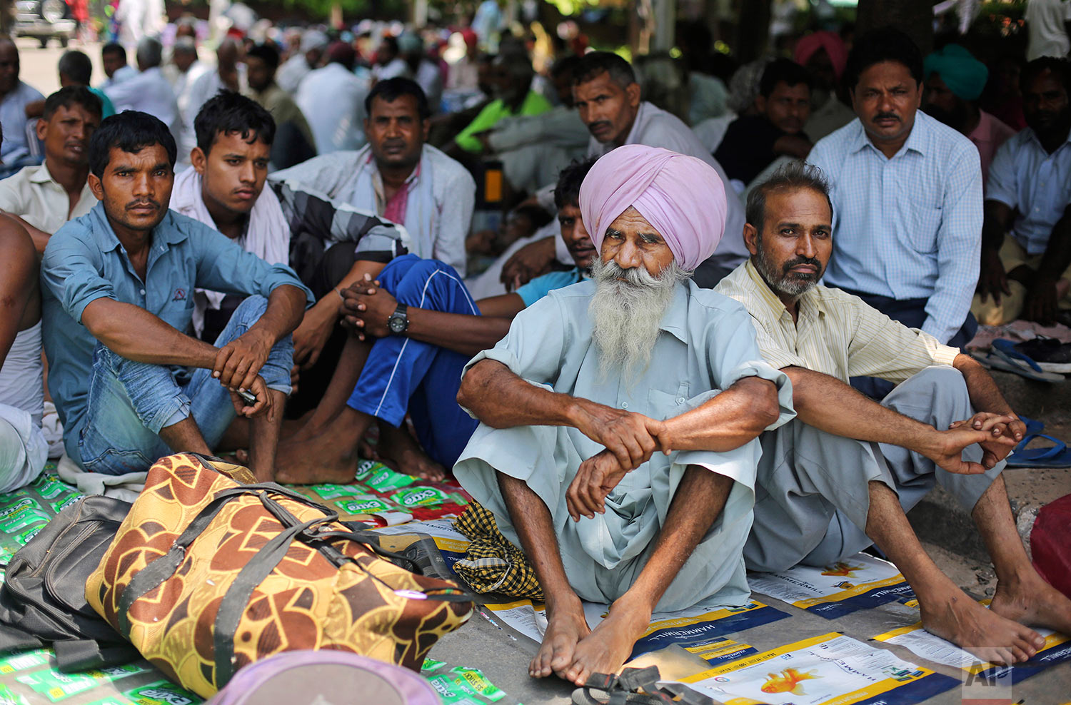 Supporters of the Dera Sacha Sauda sect squat in a public park near an Indian court in Panchkula, India, Thursday, Aug. 24, 2017.  (AP Photo/Altaf Qadri)