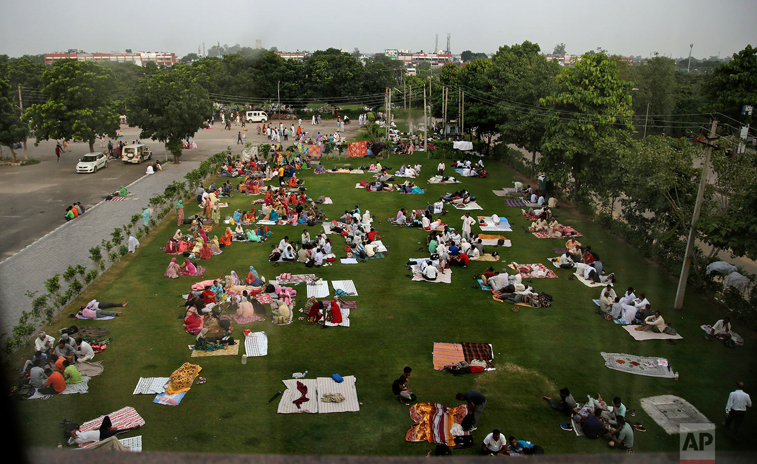 Supporters of the Dera Sacha Sauda religious sect squat in a public park near an Indian court in Panchkula, India, Friday, Aug. 25, 2017. (AP Photo/Altaf Qadri)