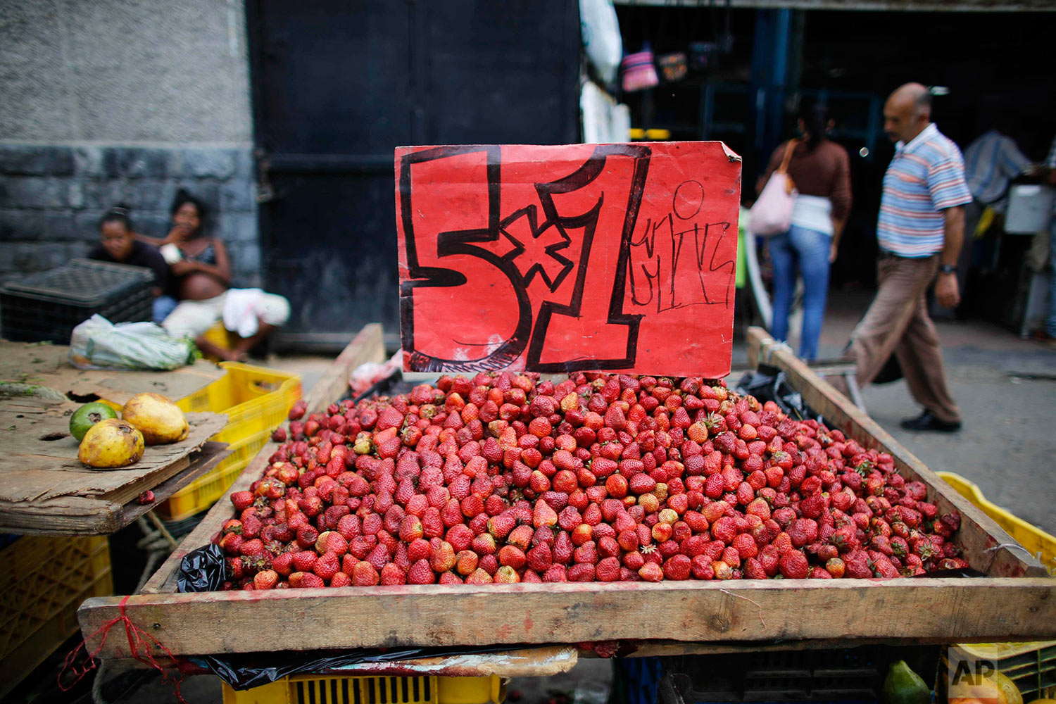 A market stall offers strawberries, Aug. 23, 2017, Caracas, Venezuela. (AP Photo/Ariana Cubillos)