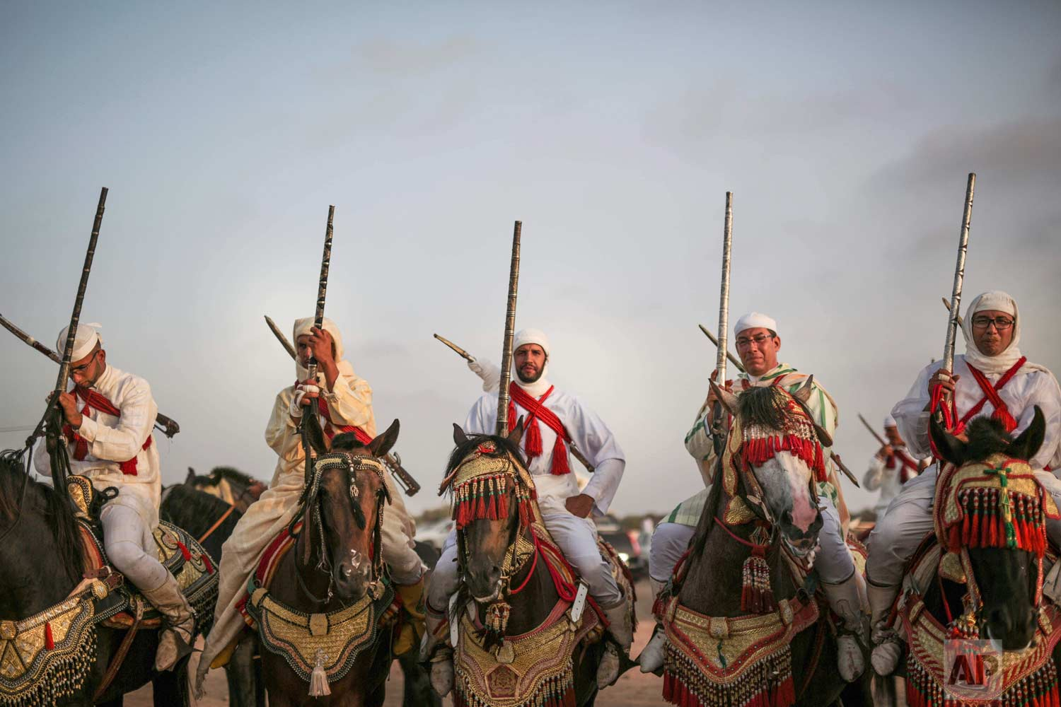 In this Thursday, Aug. 17, 2017 photo, horsemen prepare to take part in Tabourida, a traditional horse riding show also known as Fantasia, in Mansouria, near Casablanca, Morocco. (AP Photo/Mosa'ab Elshamy)