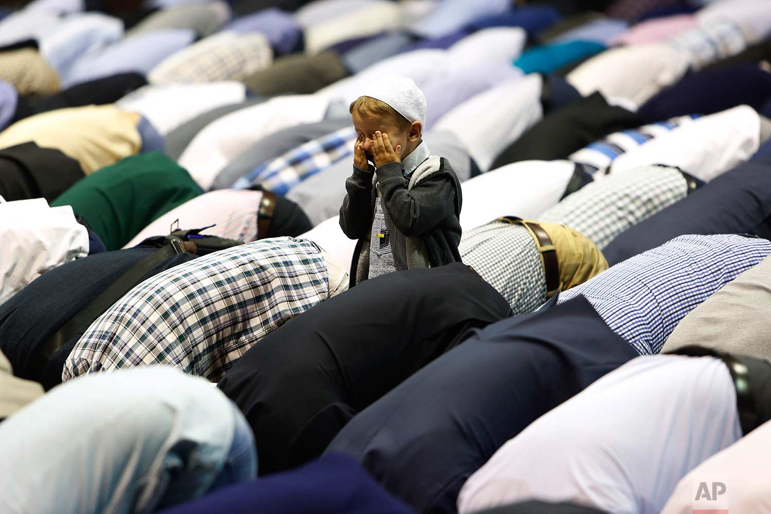 A boy offers Eid al-Adha prayers at the sport center in Sarajevo, Bosnia, Friday, Sept. 1, 2017. (AP Photo/Amel Emric)