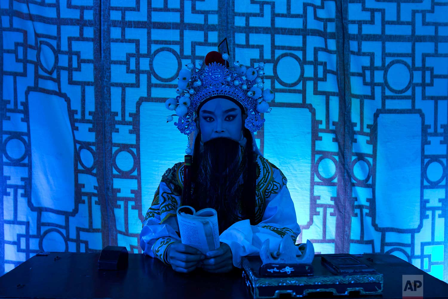"""In this Aug. 30, 2017, photo, a Chinese opera actor performs at a makeshift theater during the """"Hungry Ghost Festival"""" in Hong Kong. (AP Photo/Kin Cheung)"""