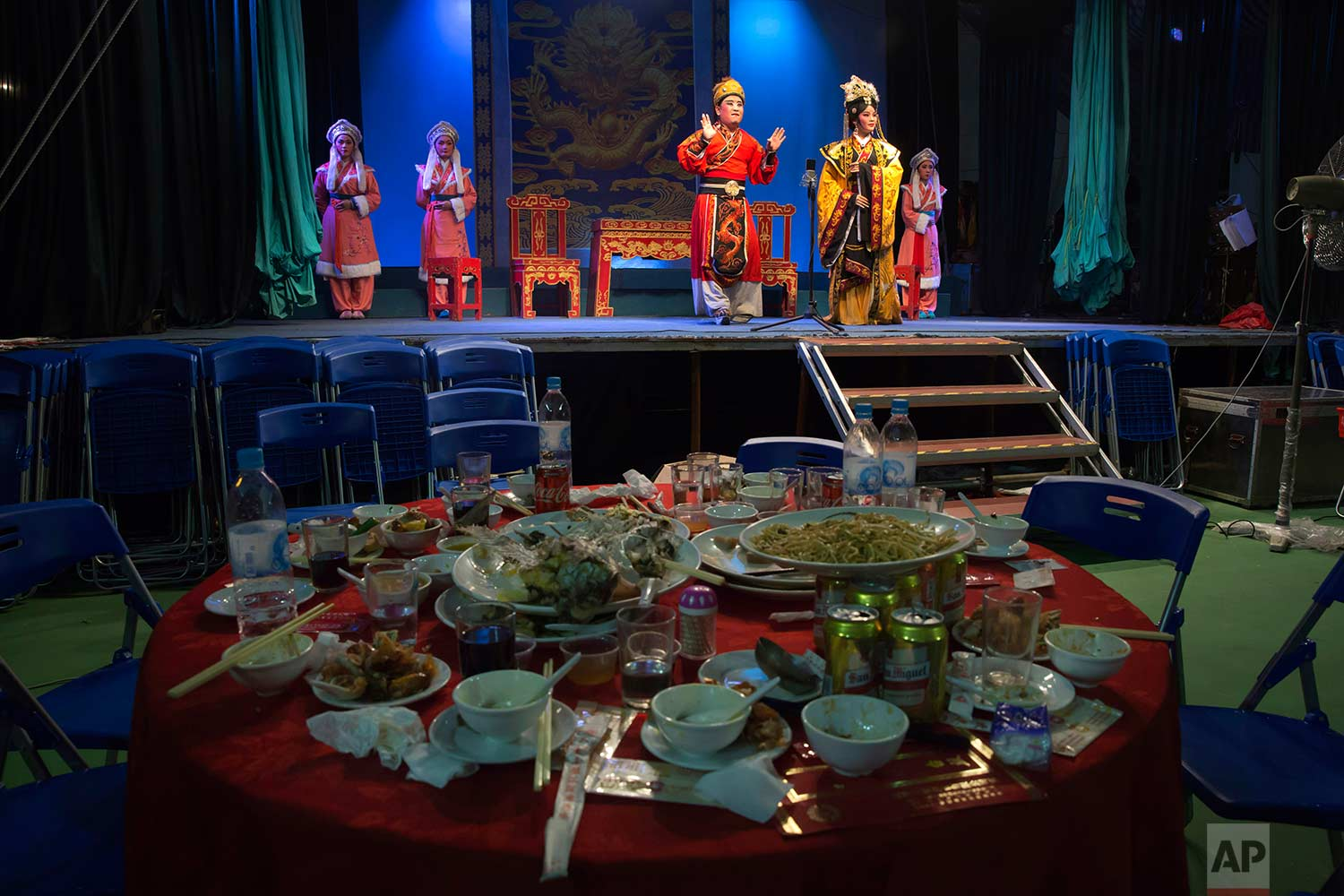 """In this Aug. 30, 2017, photo, Chinese opera artists perform at a makeshift theater during the """"Hungry Ghost Festival"""" in Hong Kong. (AP Photo/Kin Cheung)"""