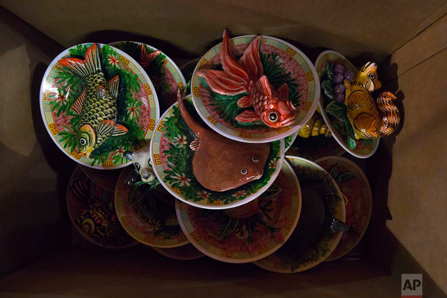 """In this Aug. 31, 2017, photo, mock fish are displayed to offer to the ancestors during the """"Hungry Ghost Festival"""" in Hong Kong. (AP Photo/Kin Cheung)"""