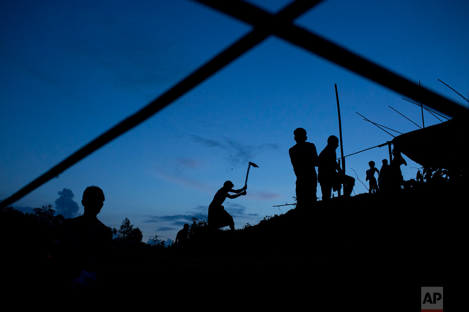 Rohingya ethnic minority, who have just crossed over to Bangladesh from Myanmar, build makeshift tents near Cox's Bazar's Gundum area, Saturday, Sept. 2, 2017. (AP Photo/Bernat Armangue)