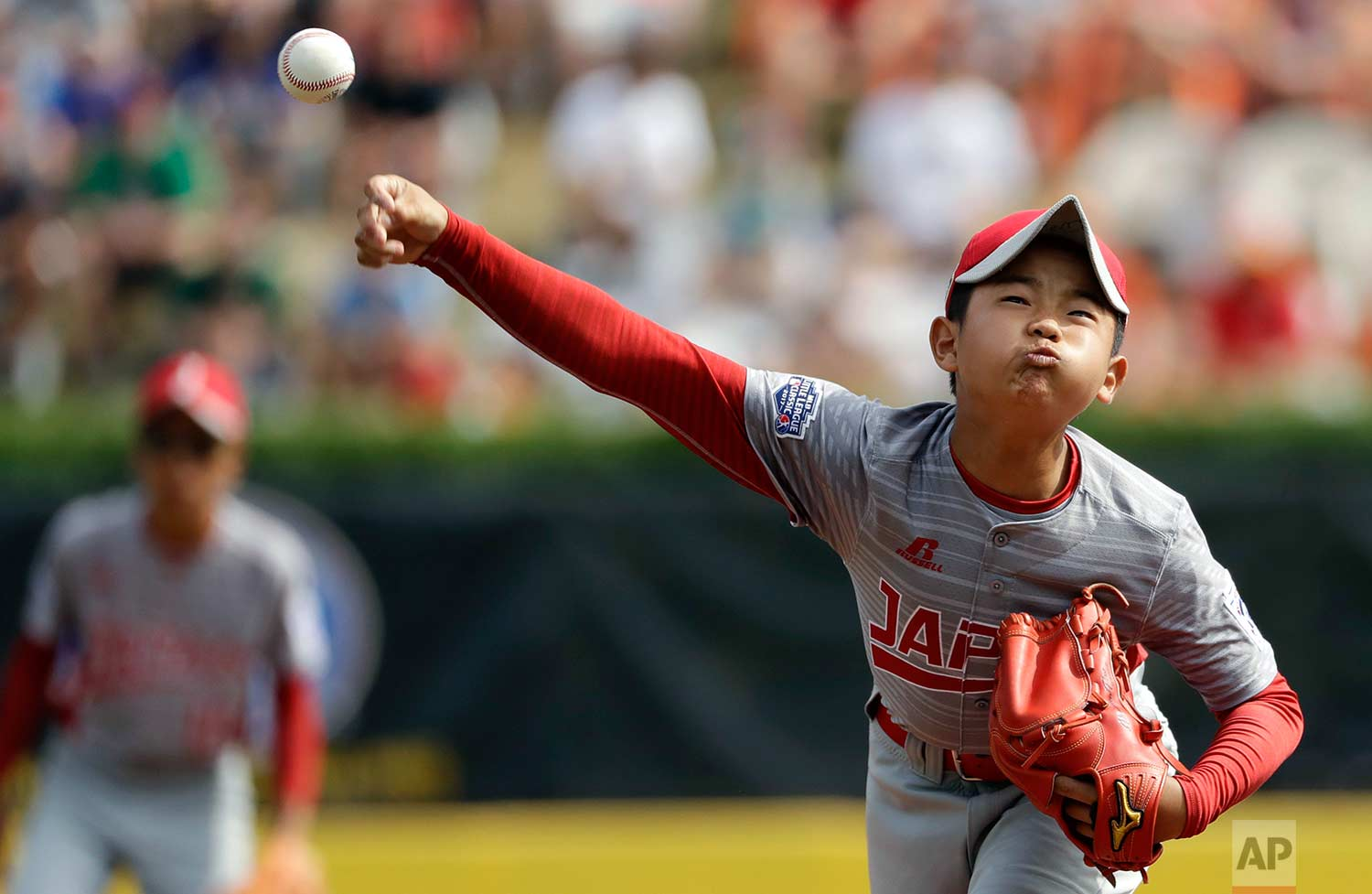 Japan's Tsubasa Tomii pitches during the first inning of Little League World Series Championship baseball game against Lufkin, Texas, Sunday, Aug. 27, 2017, in South Williamsport, Pa. (AP Photo/Matt Slocum)