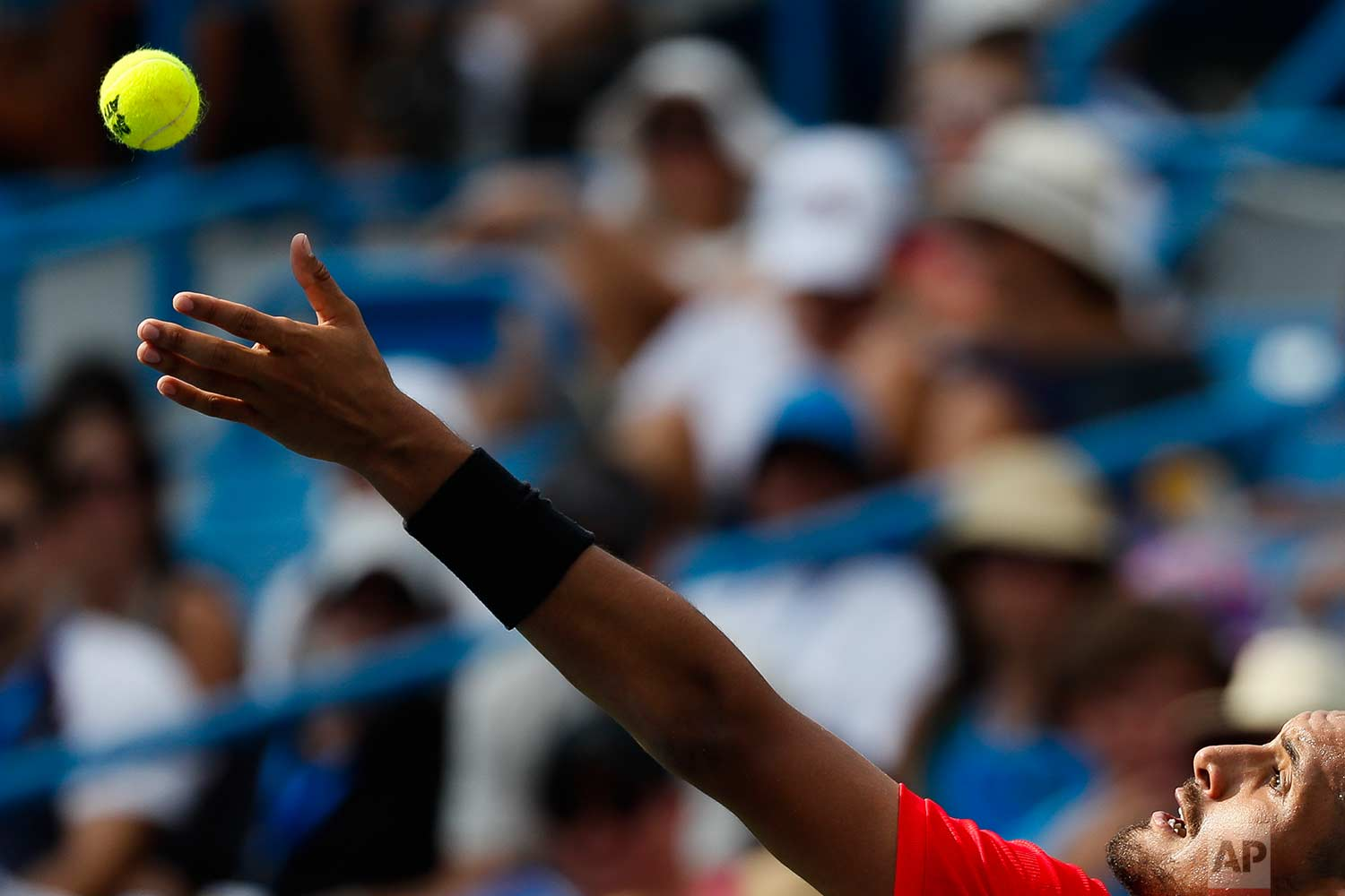 Nick Kyrgios, of Australia, serves to Grigor Dimitrov, of Bulgaria, during the men's singles final at the Western & Southern Open, Sunday, Aug. 20, 2017, in Mason, Ohio. Dimitrov won 6-3, 7-5. (AP Photo/John Minchillo)