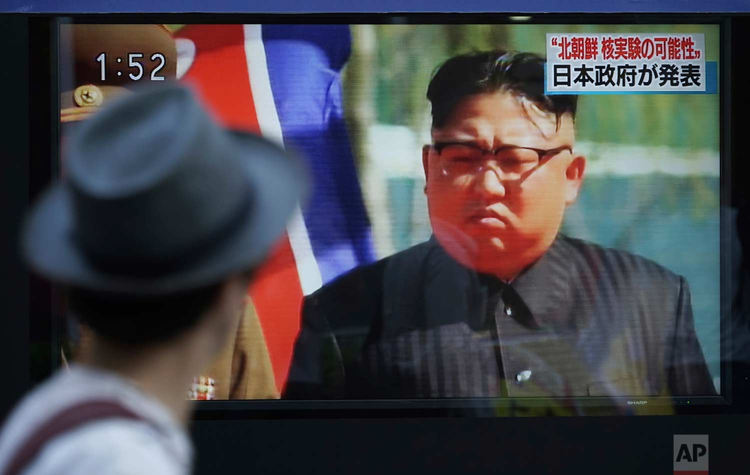 A man watches a TV news program on a public screen showing an image of North Korean leader Kim Jong Un while reporting North Korea's possible nuclear test in Tokyo Sunday, Sept. 3, 2017. South Korea's military said Sunday that North Korea is believed to have conducted its sixth nuclear test after it detected a strong earthquake, hours after Pyongyang claimed that its leader has inspected a hydrogen bomb meant for a new intercontinental ballistic missile. (AP Photo/Eugene Hoshiko)