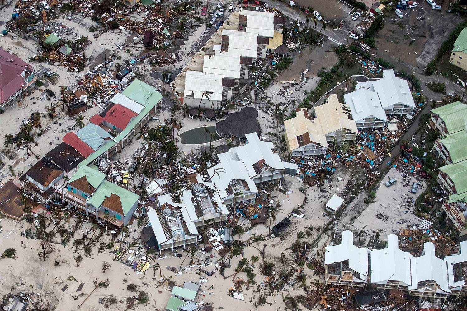 This photo provided by the Dutch Defense Ministry shows storm damage in the aftermath of Hurricane Irma, in Dutch Caribbean Sint Maarten, on Sept. 6, 2017. Irma cut a path of devastation across the northern Caribbean, leaving thousands homeless after destroying buildings and uprooting trees. Significant damage was reported on the island that is split between French and Dutch control. (Gerben Van Es/Dutch Defense Ministry via AP)