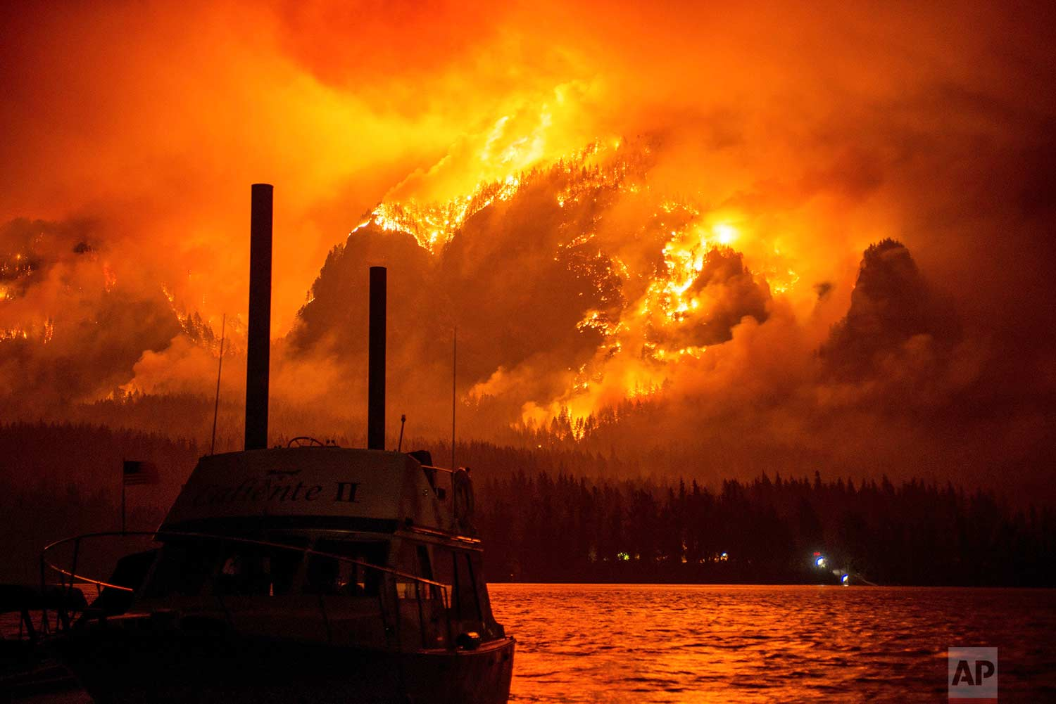 This photo provided by KATU-TV shows the Eagle Creek wildfire as seen from Stevenson Wash., across the Columbia River, burning in the Columbia River Gorge above Cascade Locks, Ore., on Monday Sept. 4, 2017. (Tristan Fortsch/KATU-TV via AP)
