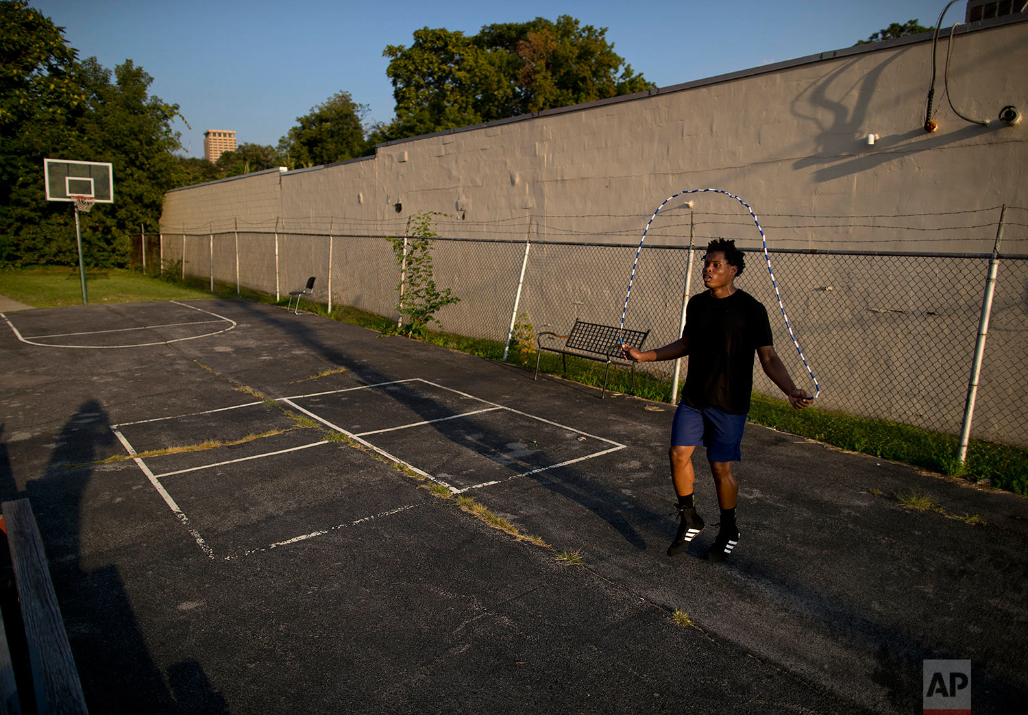 """Sai' Vaughn Coleman, 22, jumps rope outside the Faith and Hope Community Center, Monday, Aug. 21, 2017, in the South Side neighborhood of Syracuse, N.Y. Coach and mentor Arthur """"Bobby"""" Harrison, who was serving in Attica state prison in 1971 during the infamously deadly uprising, believes in providing a firm hand for the teens who train here. (AP Photo/Julie Jacobson)"""