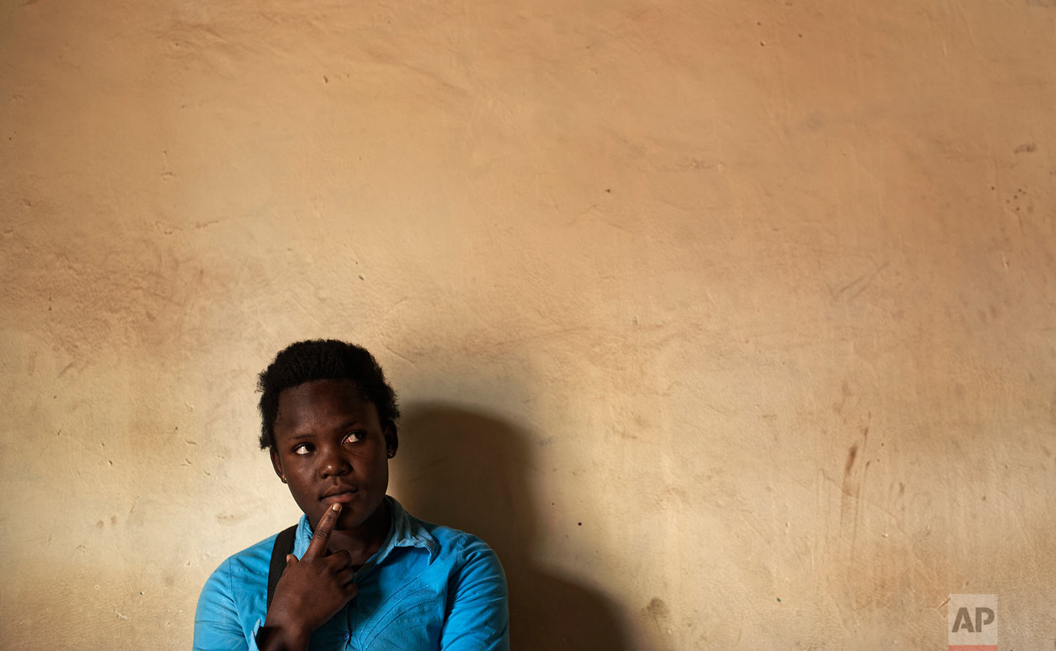 In this Wednesday, May 31, 2017 photo, Asimart Nakabanda, 15, whose child marriage was foiled at the planned wedding ceremony in a surprise raid by police, discusses the events in the village of Lwamaggwa, near Masaka, in Uganda.  (AP Photo/Ben Curtis)