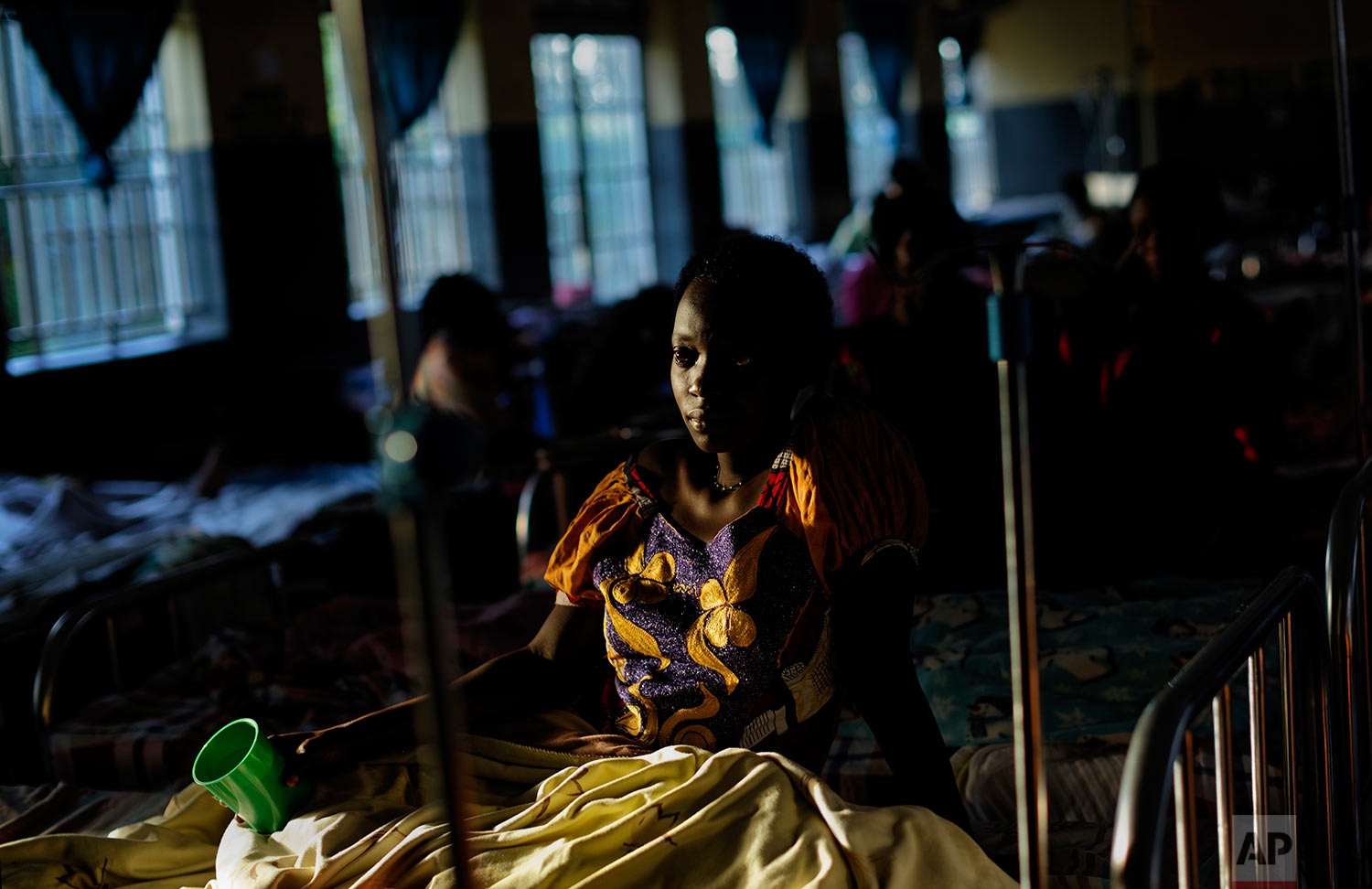 In this Wednesday, May 31, 2017 photo, expectant mothers lie on beds in the maternity ward of the Kalisizo General Hospital in Kalisizo, Uganda. (AP Photo/Ben Curtis)